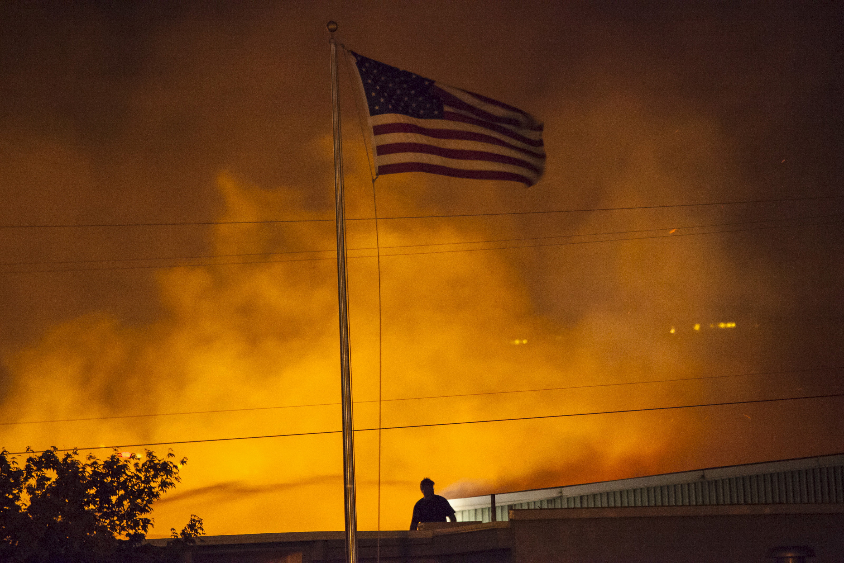 A commercial building burns after being ignited by the Sleepy Hollow fire in Wenatchee, Washington June 29, 2015