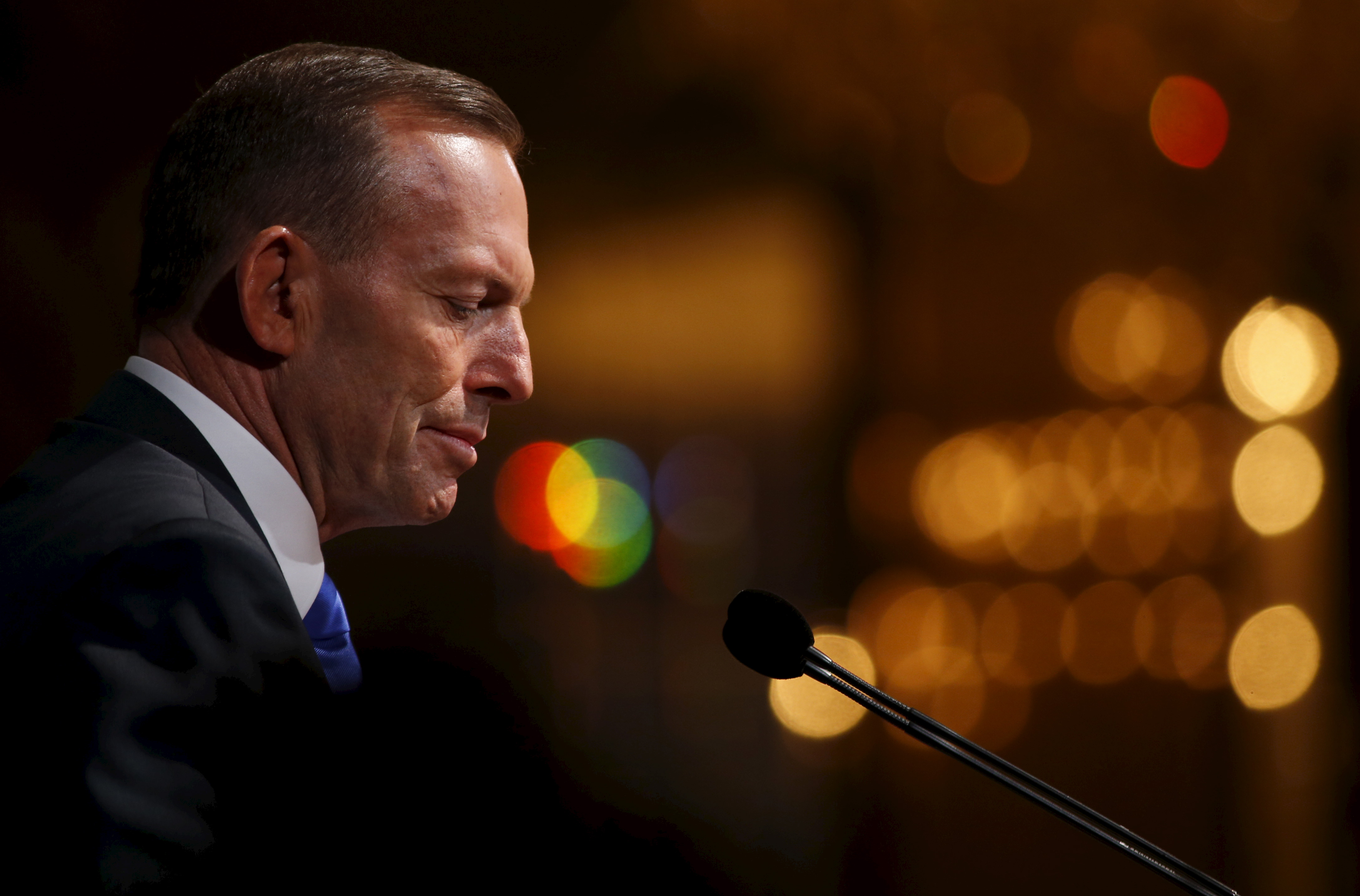 Australia's Prime Minister Tony Abbott delivers a lecture titled  Our Common Challenges: Strengthening Security in the Region  in Singapore on June 29, 2015