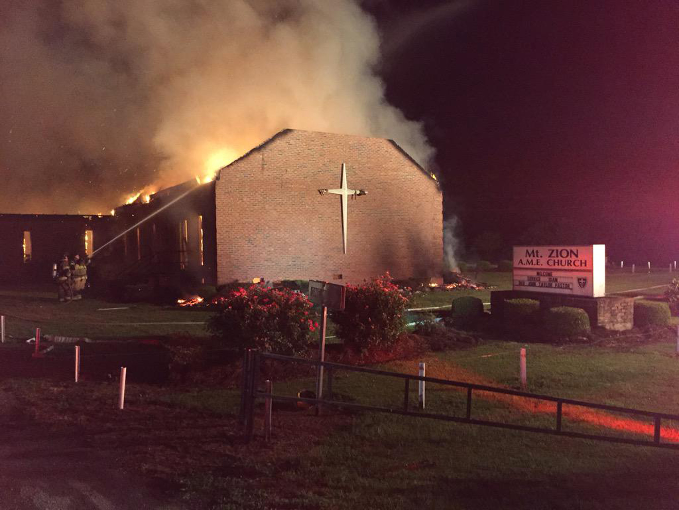 Fire crews try to control a blaze at the Mt. Zion African Methodist Episcopal Church in Greeleyville, S.C., on the night of June 30, 2015