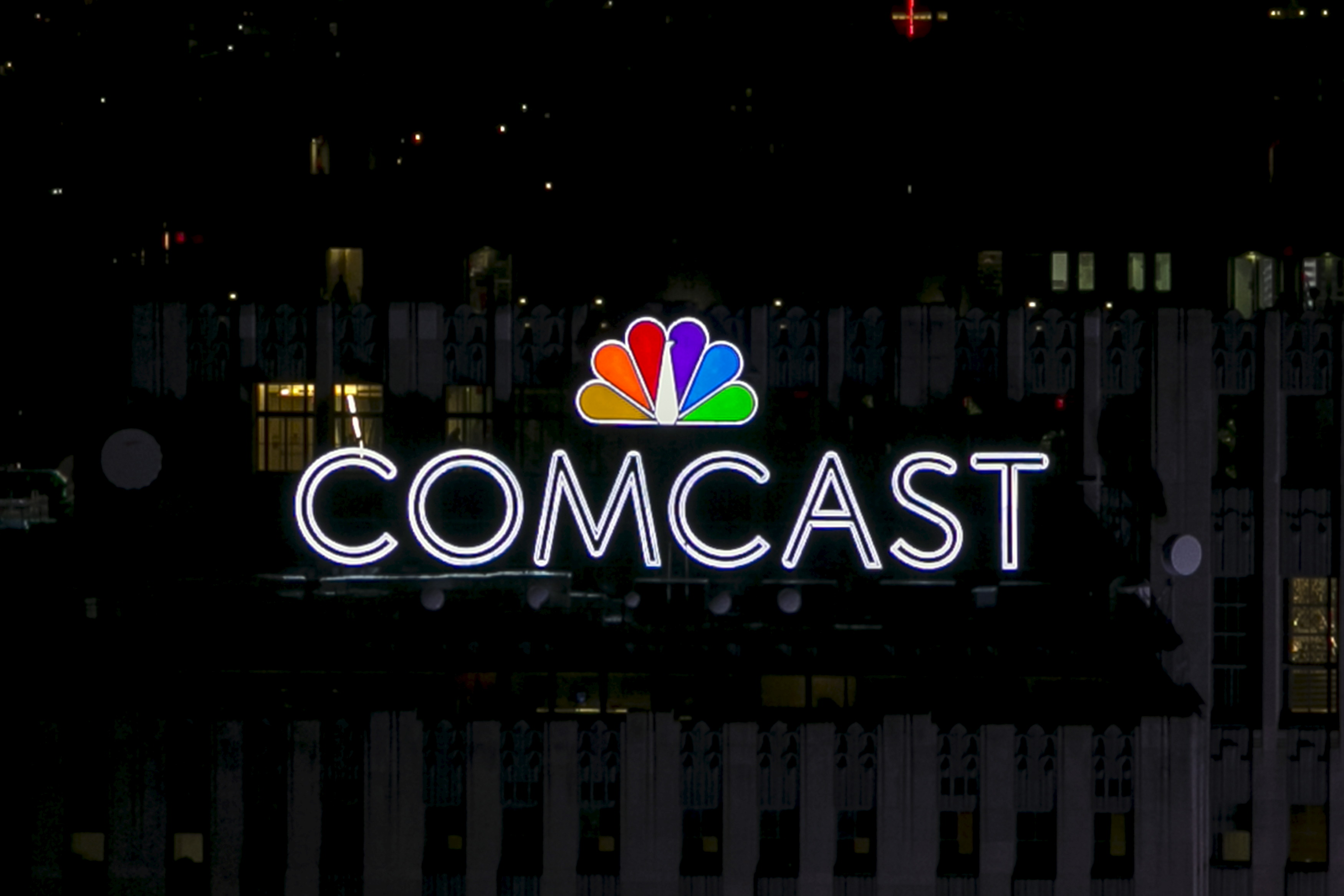 The NBC and Comcast logo are displayed on top of 30 Rockefeller Plaza, formerly known as the GE building, in midtown Manhattan in New York July 1, 2015.
