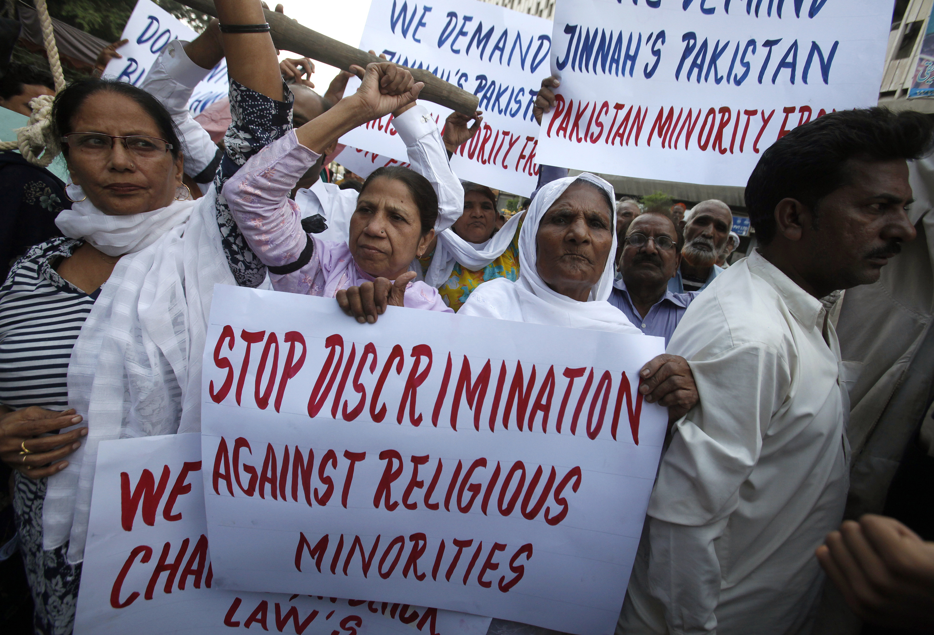 Protesters hold up placards while demanding the release of Asia Bibi, a Pakistani Christian woman sentenced to death for blasphemy, at a rally in Karachi on Nov. 25, 2010