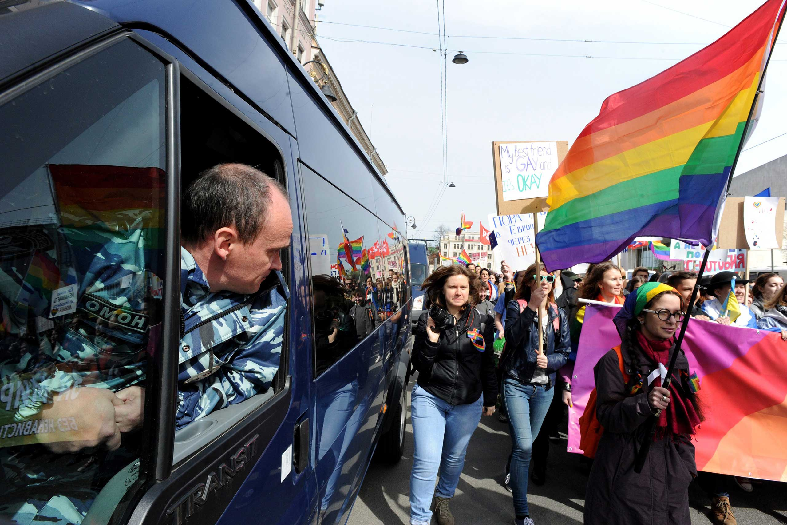 A policeman looks out from a truck as members and supporters of the LGBT community take part in a May Day rally in Saint Petersburg on May 1, 2015.