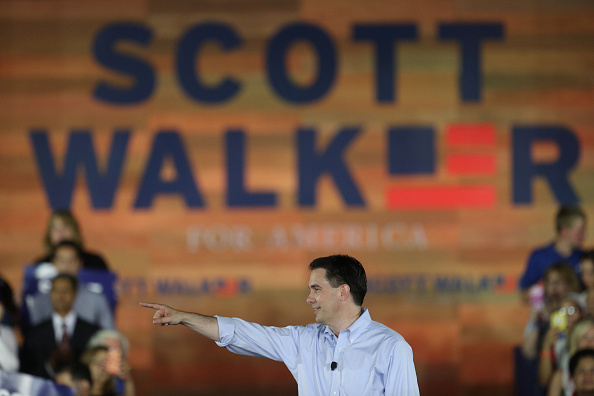Scott Walker, governor of Wisconsin, takes the stage during his presidential campaign announcement in Waukesha, Wisconsin, U.S., on Monday, July 13, 2015.