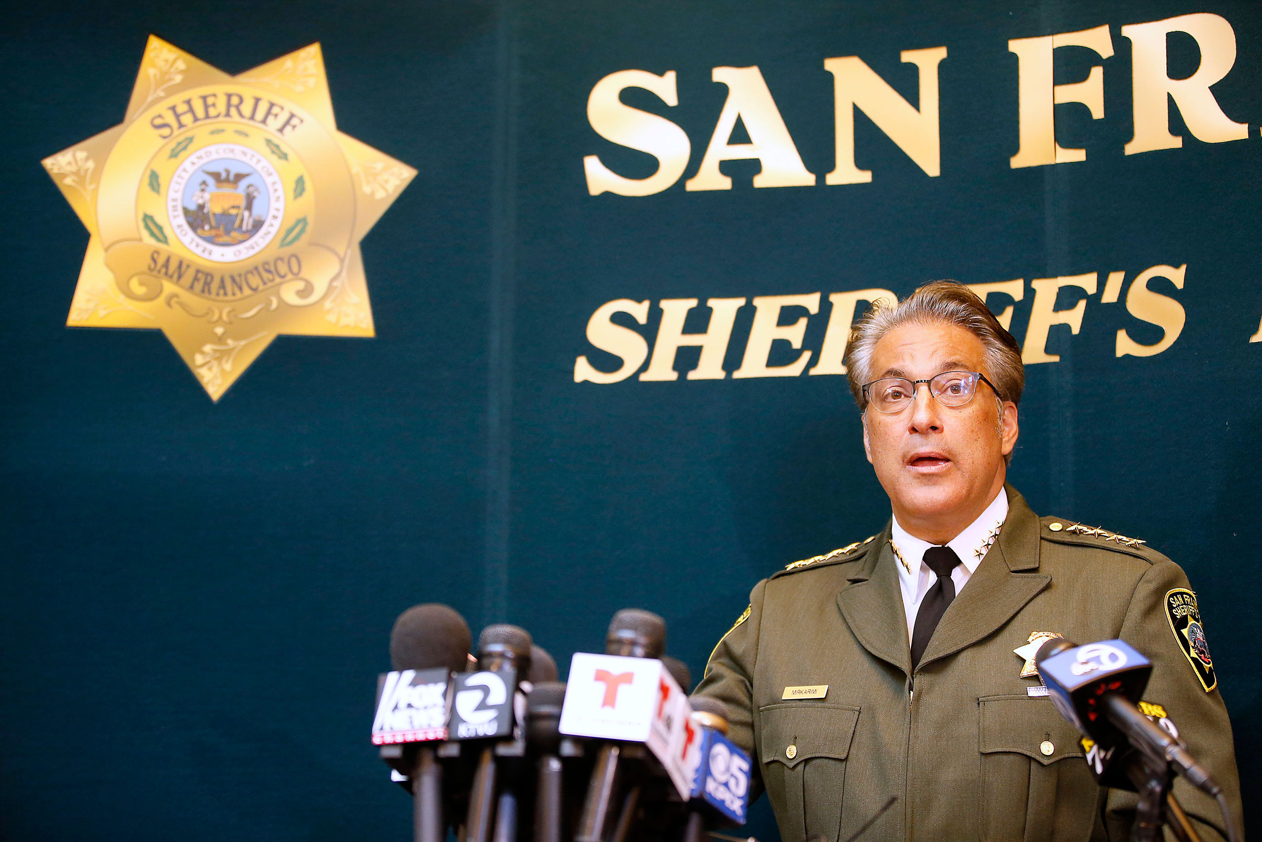San Francisco Sheriff Ross Mirkarimi fields questions during a news conference in San Francisco on July 10, 2015.