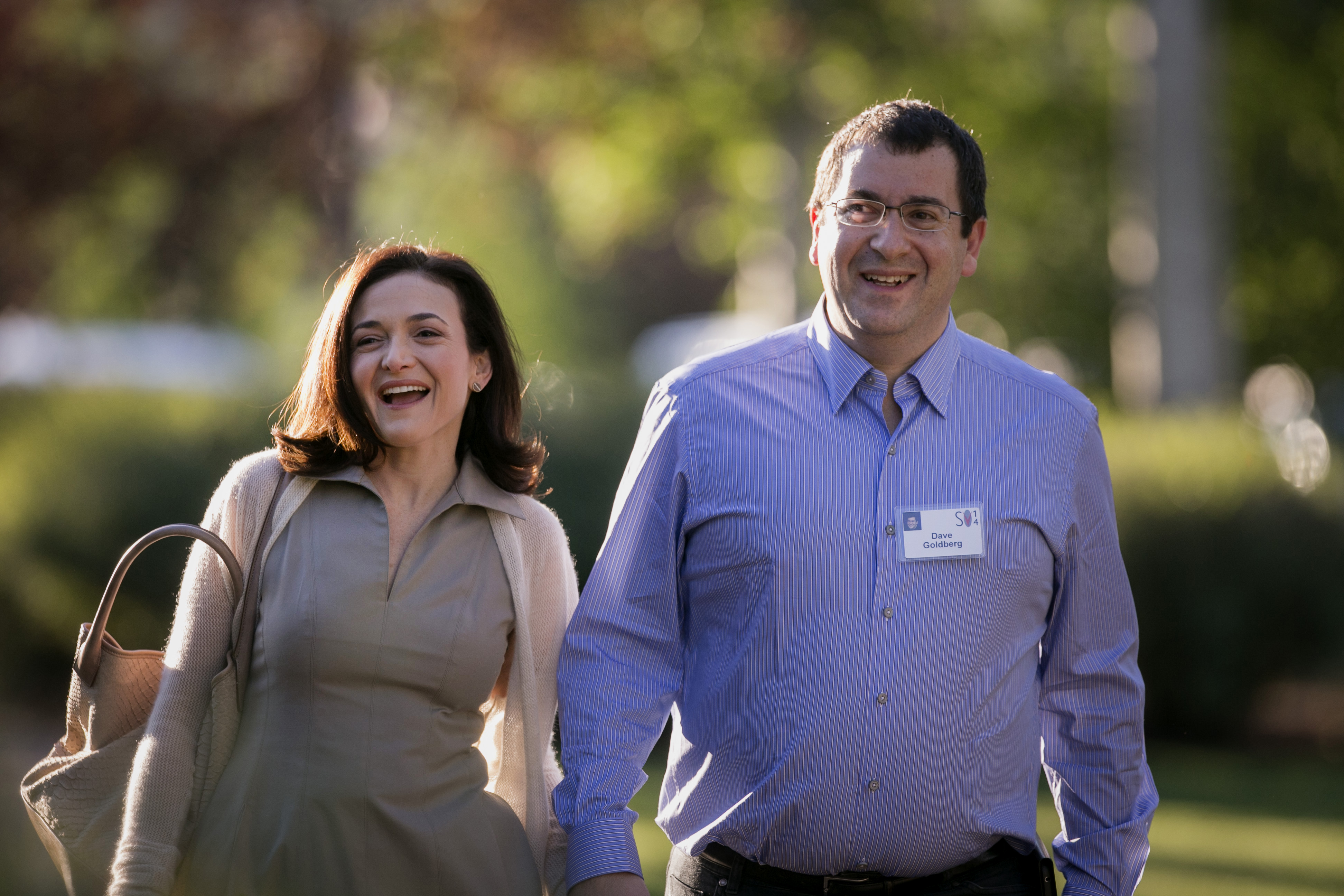 Sheryl Sandberg, chief operating officer of Facebook Inc., left, and her husband David  Dave  Goldberg, chief executive officer of SurveyMonkey, arrive to a morning session at the Sun Valley Lodge during the Allen & Co. Media and Technology Conference in Sun Valley, Idaho, U.S., on Wednesday, July 9, 2014.