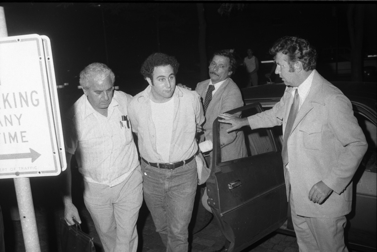 Police escort handcuffed Son of Sam suspect David Berkowitz into Police headquarters in lower Manhattan