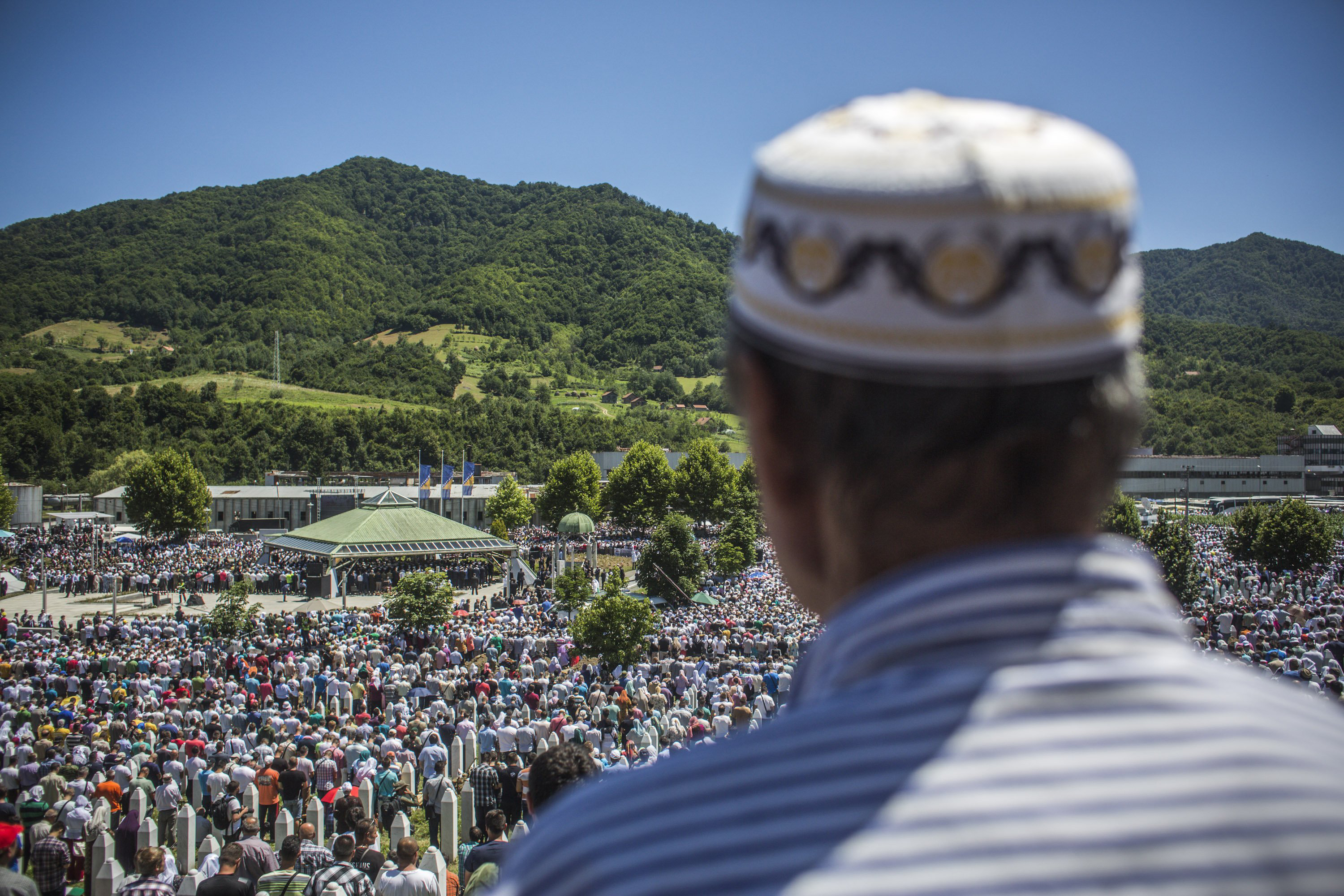 Muslims pray at the mass funeral for 136 newly-identified victims of the 1995 Srebrenica massacre at the Potocari cemetery and memorial on July 11, 2015 in Srebrenica, Bosnia.