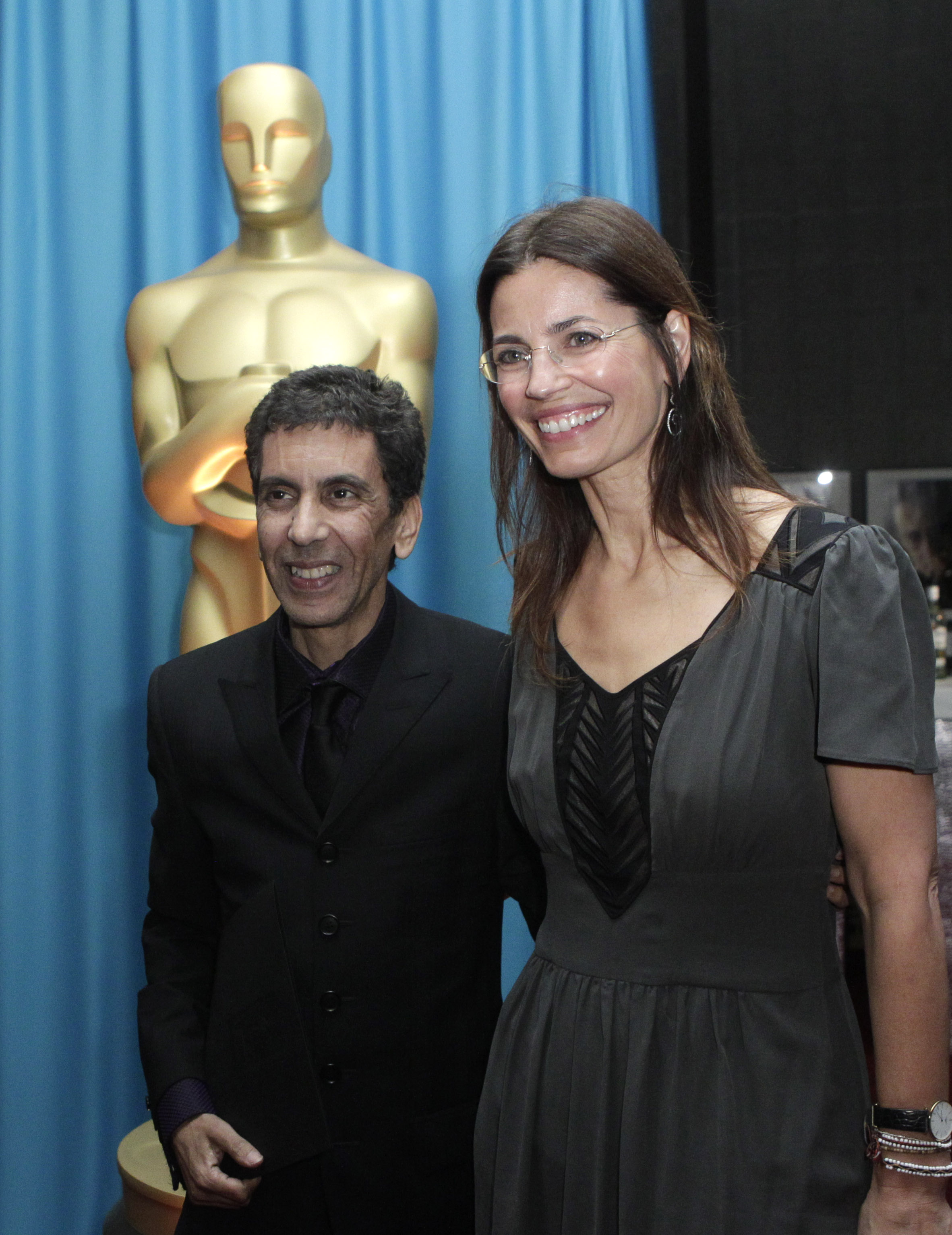 Screenwriter Susanna Grant (R) and Rachid Bouchareb, a French-Algerian director at the Foreign Language Award Directors reception in Beverly Hills, Calif. on Feb. 25, 2011.