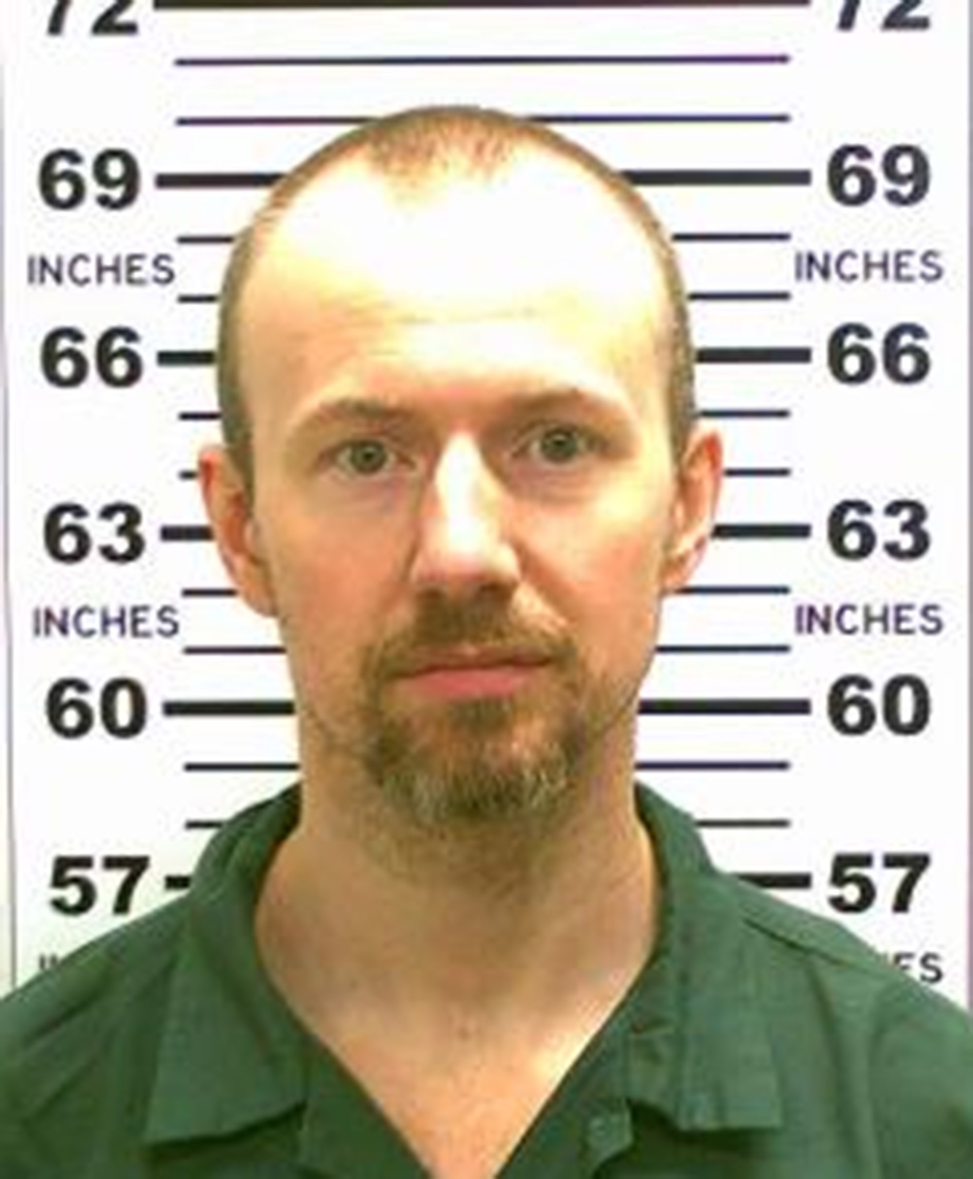 In this handout from New York State Police, convicted murderer David Sweat (L) is shown. Richard Matt, 48, and Sweat, 34, escaped from the maximum security prison June 6, 2015 using power tools and going through a manhole.