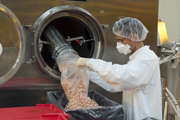 An employee works in the tablet production plant at Teva Pharmaceutical Industries Ltd.'s headquarters in Jerusalem on Sept. 19, 2011.