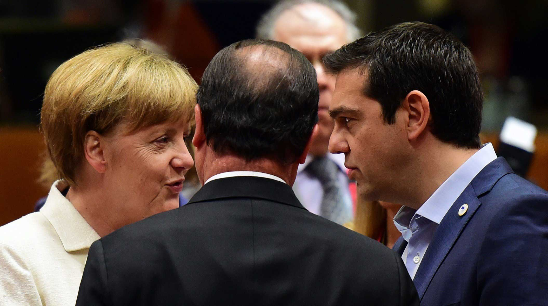 From left: German Chancellor Angela Merkel, French President Francois Hollande, and Greek Prime Minister Alexis Tsipras confer prior to the start of a summit of Eurozone heads of state in Brussels on July 12, 2015.
