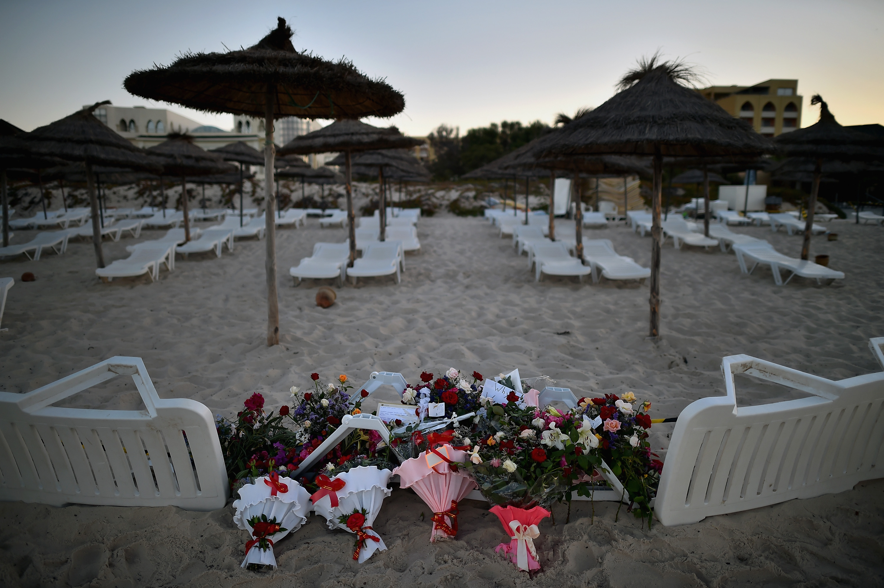 Flowers are placed on June 27, 2015, at the beach next to the Imperial Marhaba Hotel in Sousse, Tunisia, where 38 people were killed in a terrorist attack a day earlier