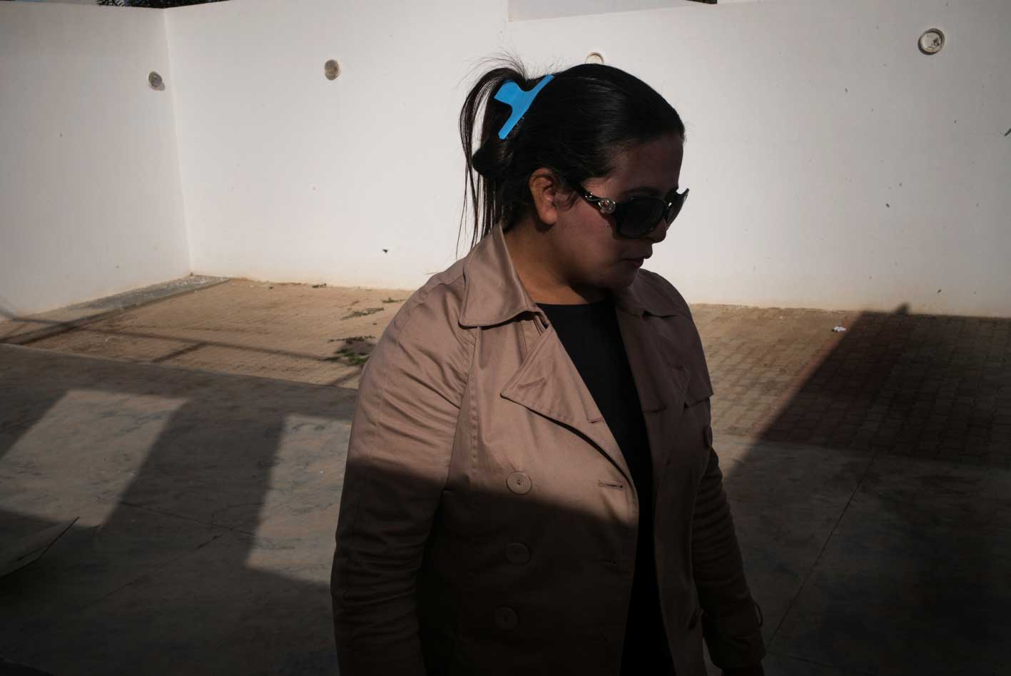 Hayet Amami, 33, works with young people in her impoverished hometown of Sidi Bouzid to discourage them from joining jihadists in Syria. She says her brother Jabeur, an unemployed engineering graduate, became increasingly isolated and aggressive before he left the country to join ISIS in July 2014. When he returned to Tunisia in September, authorities arrested him on charges of belonging to a terrorist cell. He is still awaiting trial in Tunisia's Mornaguia Prison, the country's largest facility.