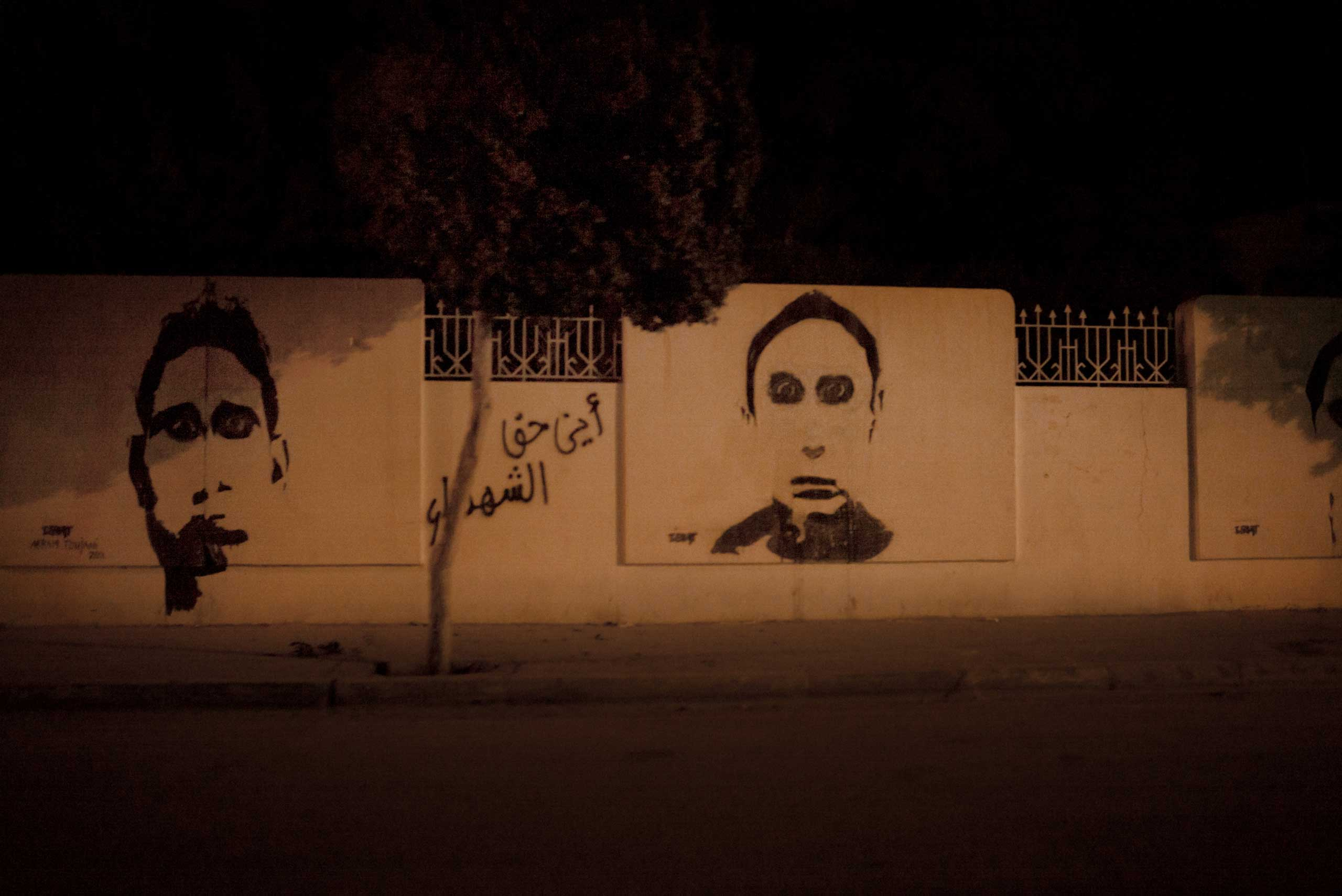 The graffiti above memorializes fighters who died helping to overthrow the ruling Tunisian government in 2011. Correction: The original version of this caption incorrectly described the graffiti.