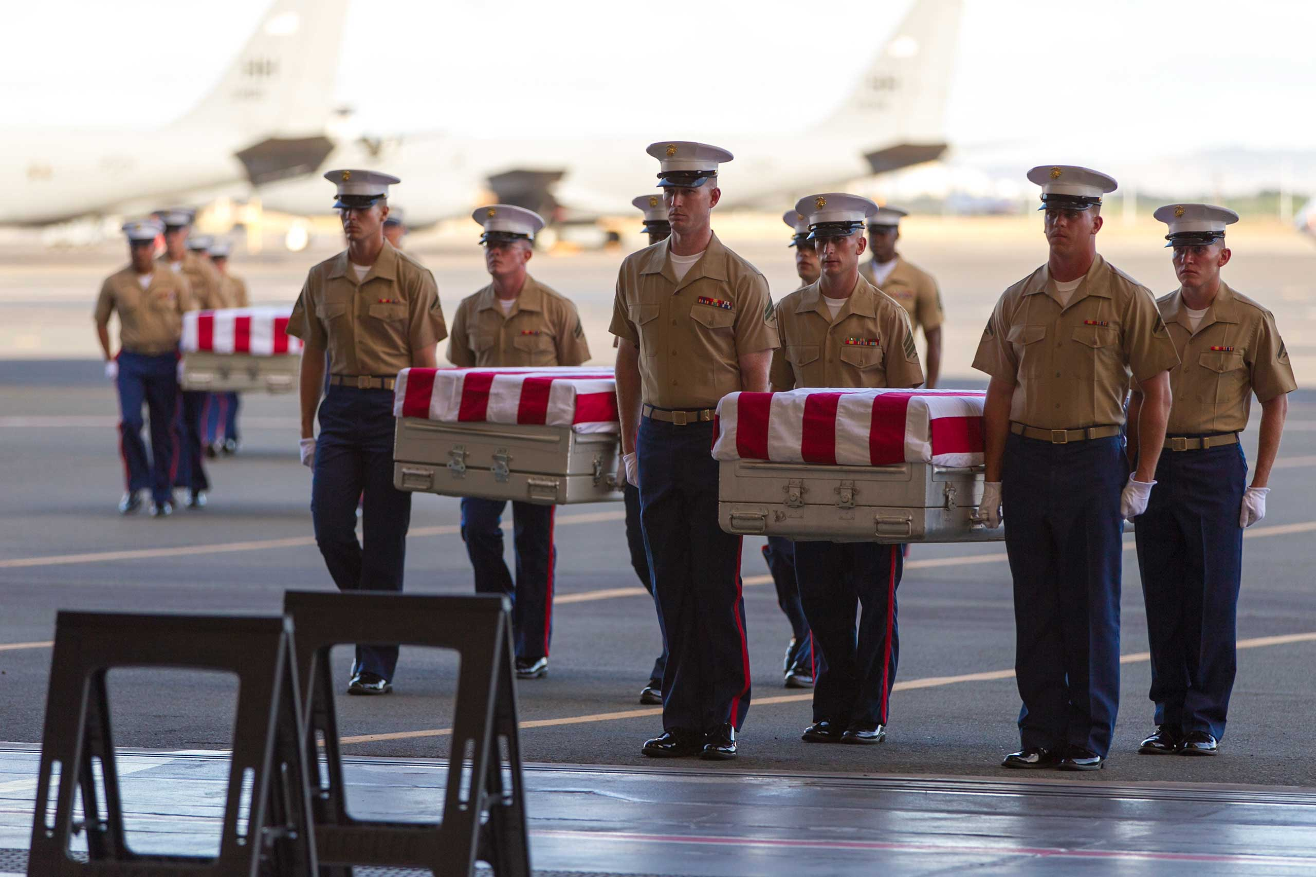 U.S. Marines carry the remains of 36 unidentified Marines found at a World War II battlefield during a ceremony at Joint Base Pearl Harbor-Hickam, July 26, 2015, in Honolulu.