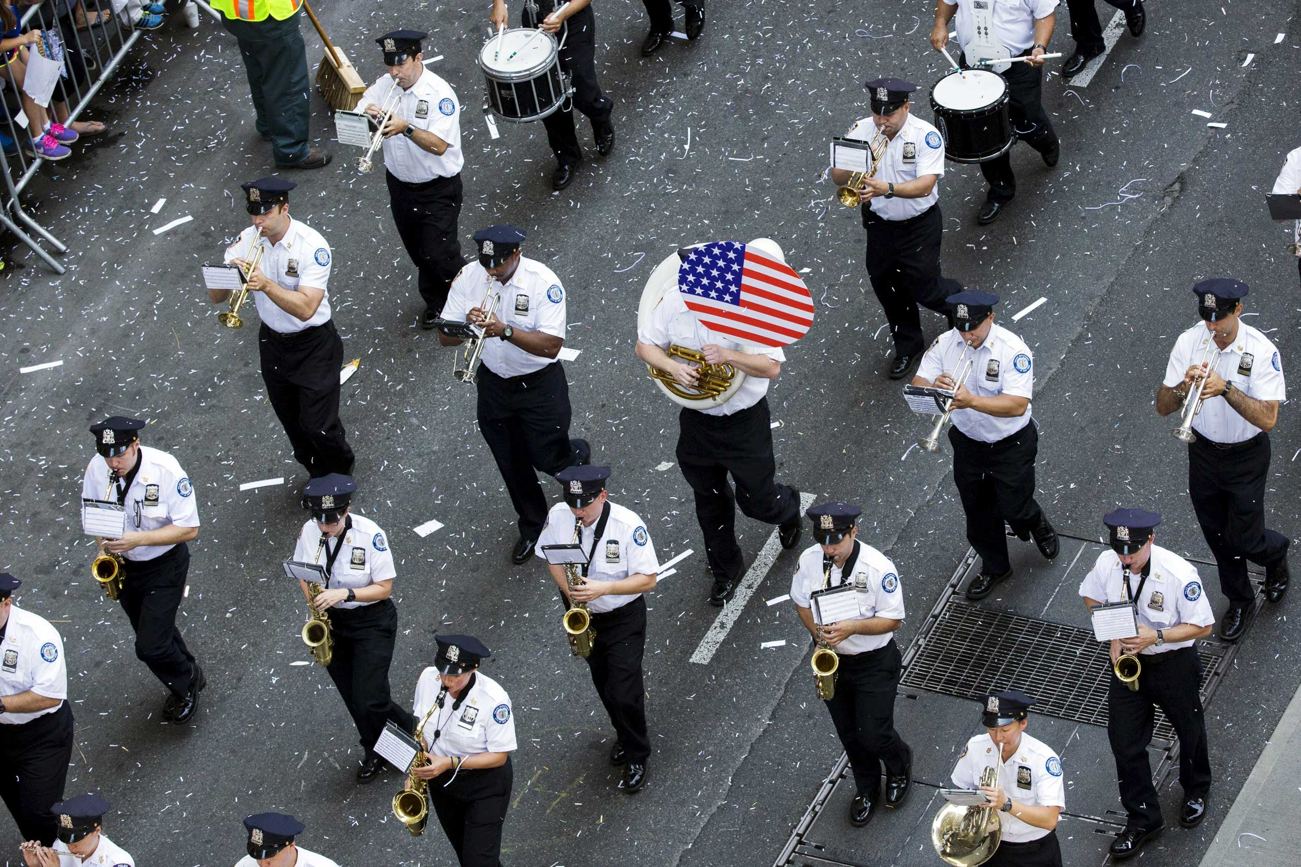 A band plays during the ticker tape parade to celebrate the U.S. women's soccer team World Cup victory in New York City on July 10, 2015.