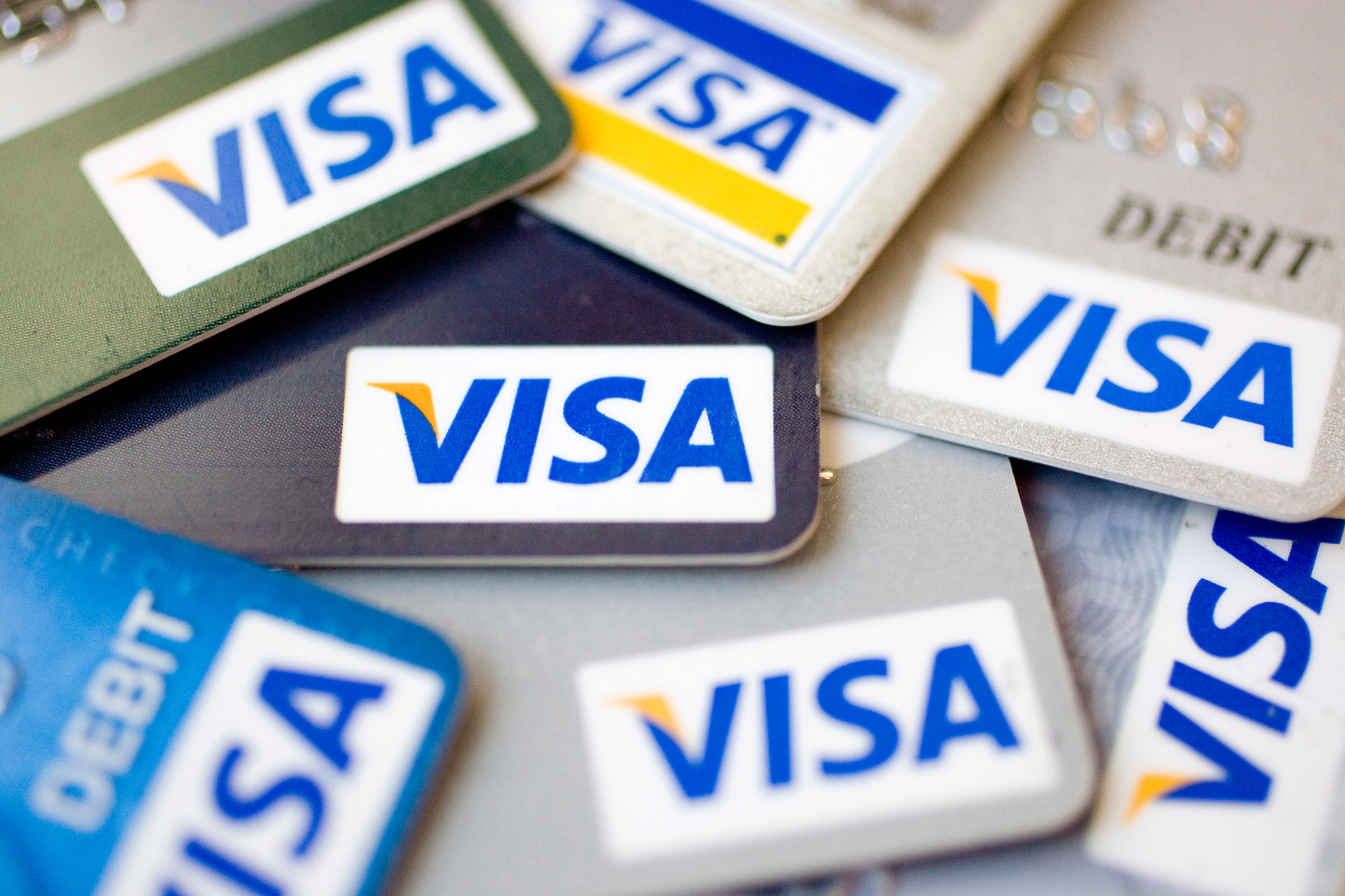 Visa logos appear on credit and debit cards in New York, on July 30, 2009.
