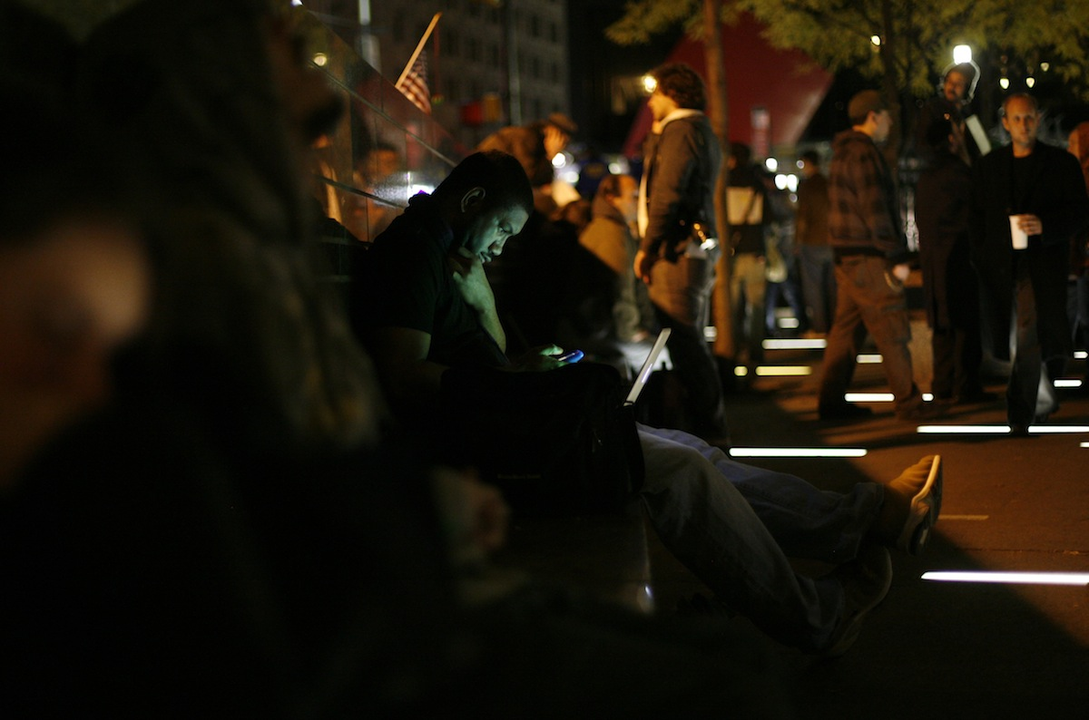 A man uses a computer at Zuccotti Park in lower Manhattan during Occupy Wall Street, Nov. 15, 2011.