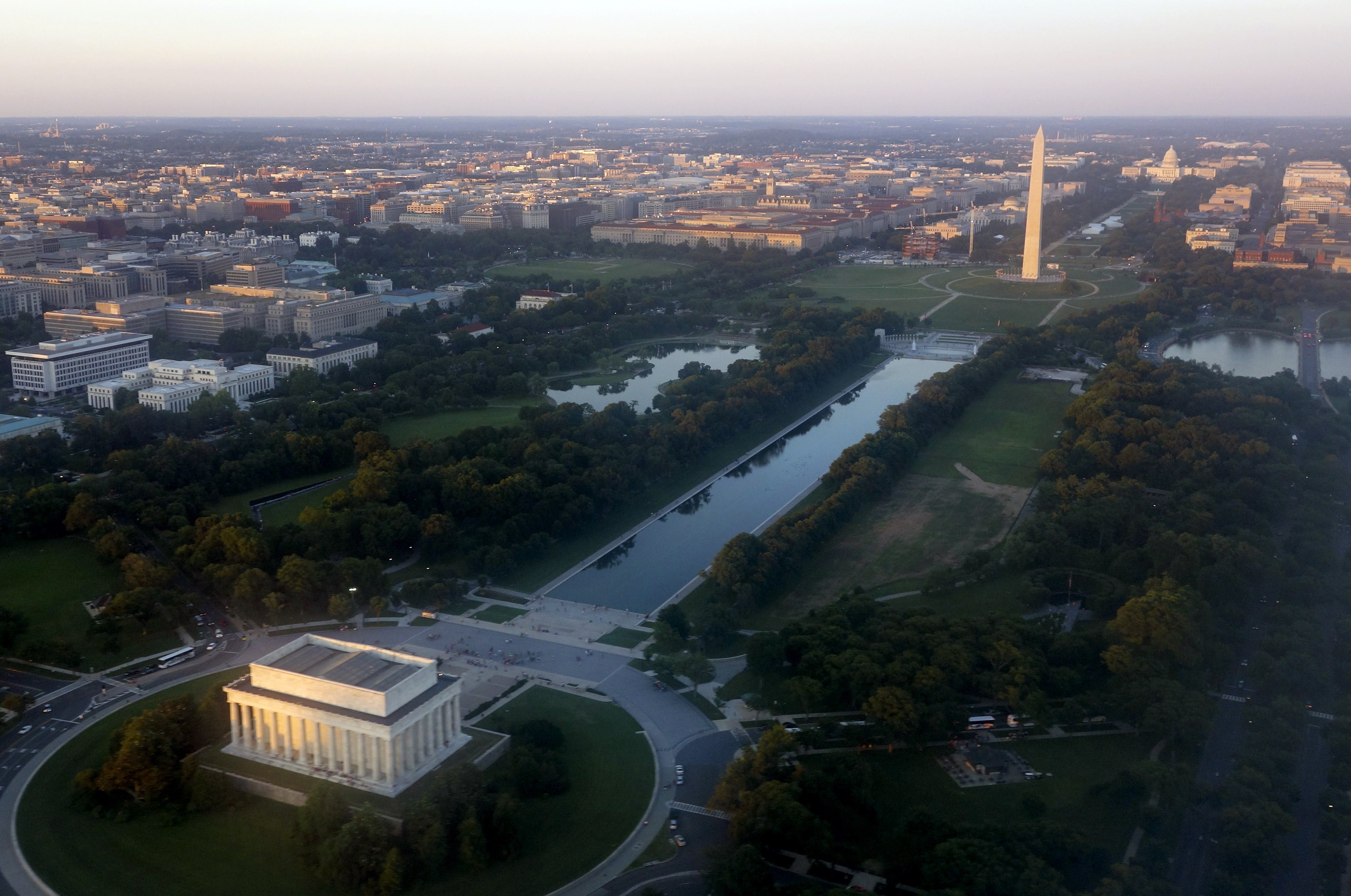 The skyline of Washington, DC, including the Lincoln Memorial, Washington Monument, US Capitol and National Mall, is seen from the air at sunset in this photograph taken on June 15, 2014.