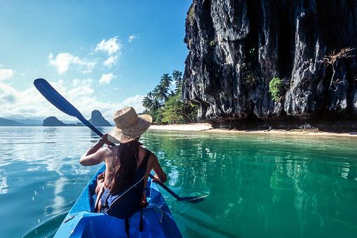 woman-kayaking-rear-view