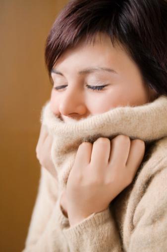 woman-turtleneck-shivering
