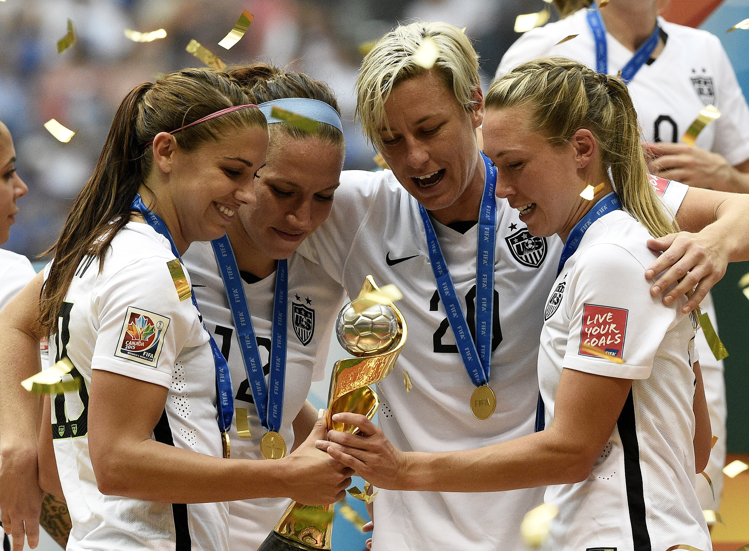 L-R: Alex Morgan, Lauren Holiday, Abby Wambach and Whitney Engen celebrate after winning the final 2015 FIFA Women's World Cup match between USA and Japan at the BC Place Stadium in Vancouver on July 5, 2015.