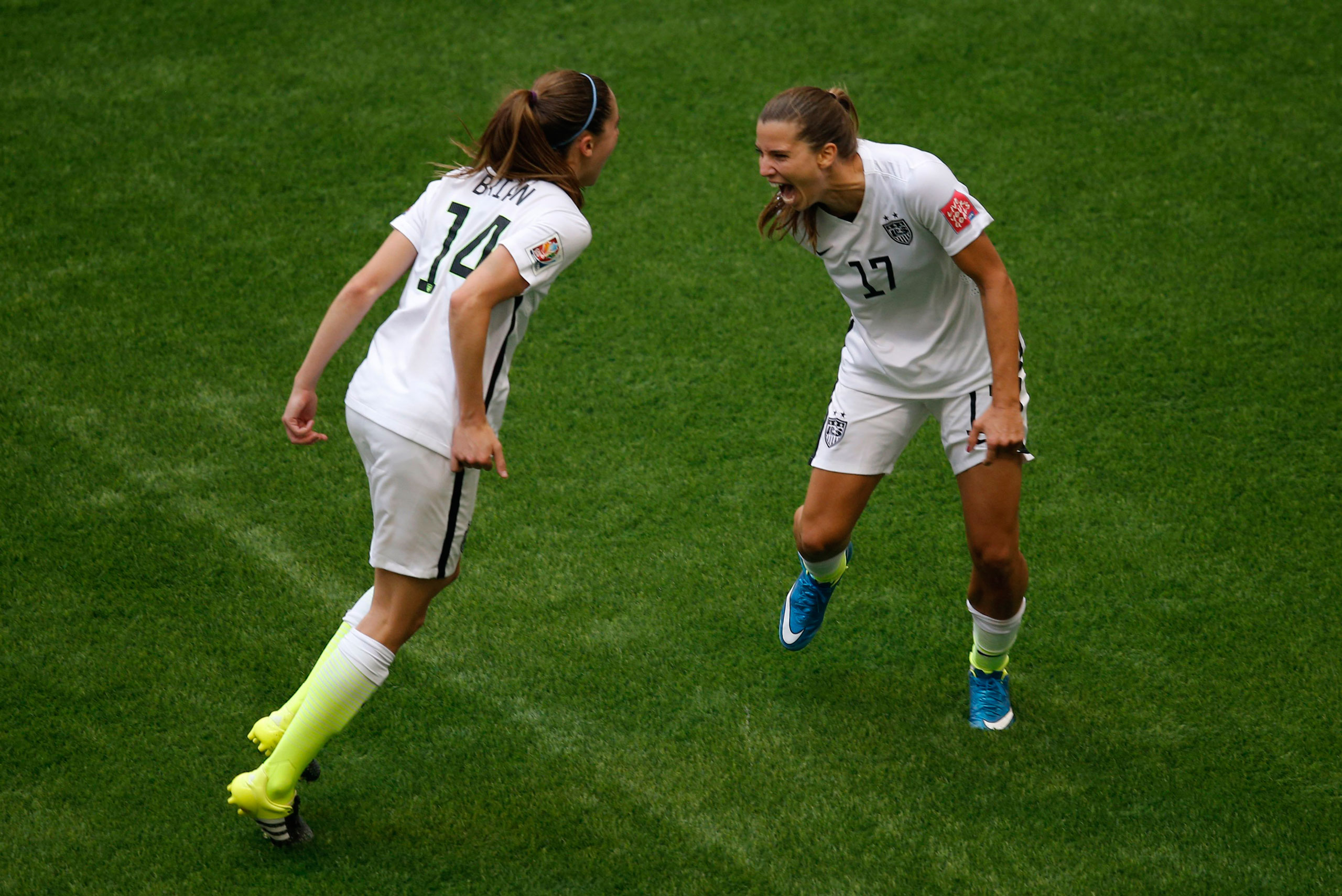 Tobin Heath celebrates with midfielder Morgan Brian after scoring against Japan during the second half of the final of the FIFA 2015 Women's World Cup at BC Place Stadium in Vancouver, on July 5, 2015.