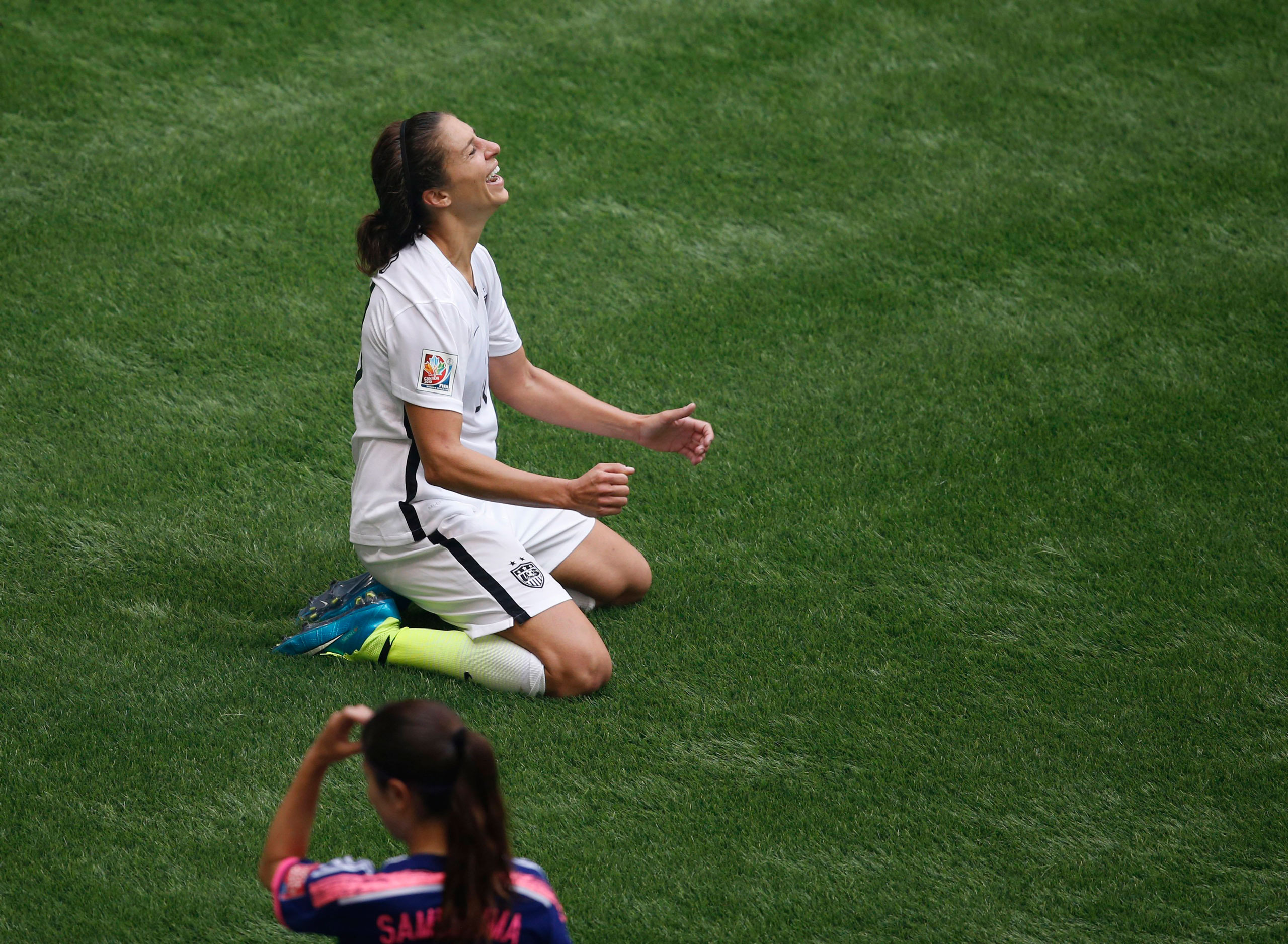 Carli Lloyd reacts after defeating Japan in the final of the FIFA 2015 Women's World Cup at BC Place Stadium in Vancouver on July 5, 2015.