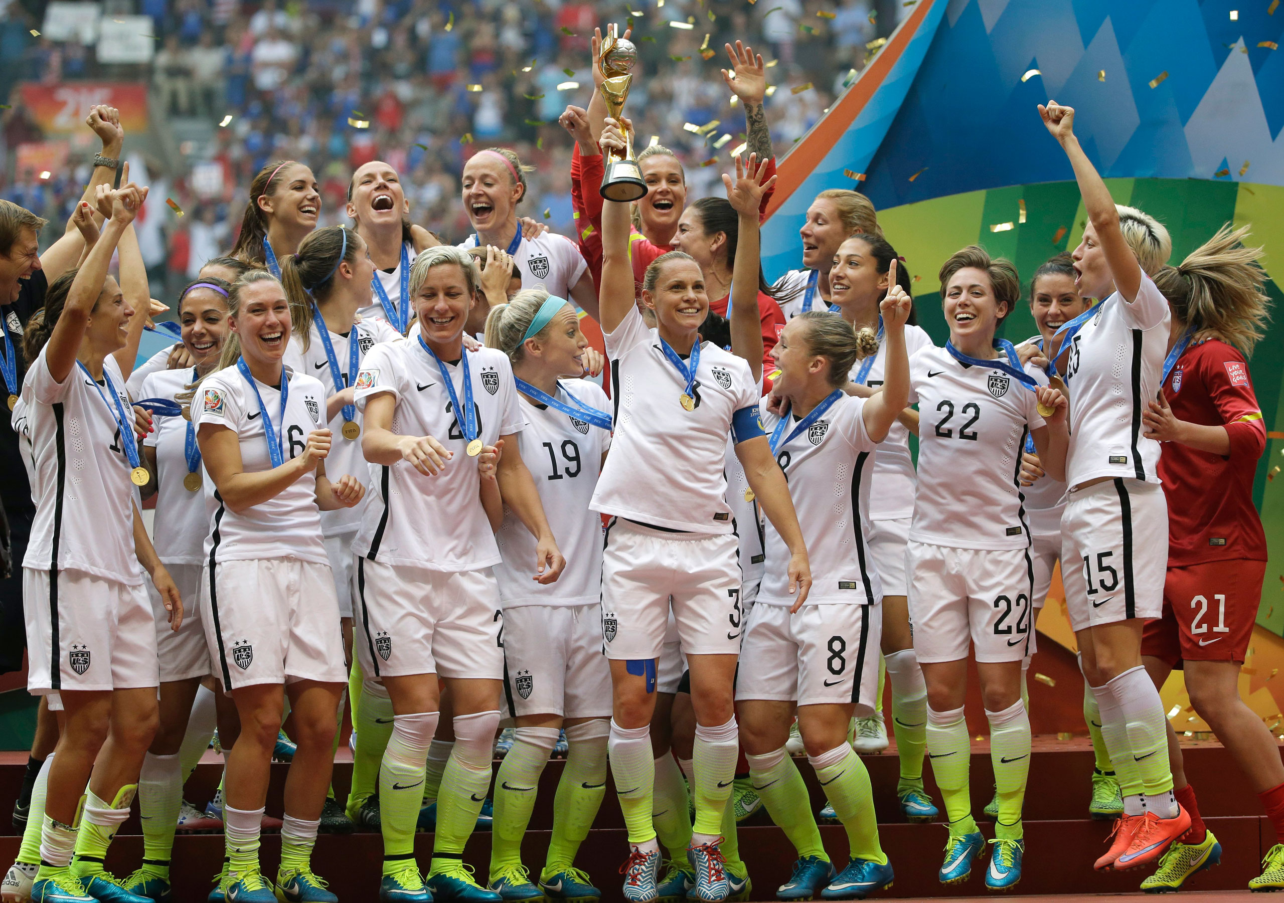 The U.S.A. Women's National Team celebrates with the trophy after they beat Japan 5-2 in the final match of the 2015 FIFA Women's World Cup at the BC Place Stadium in Vancouver on July 5, 2015.