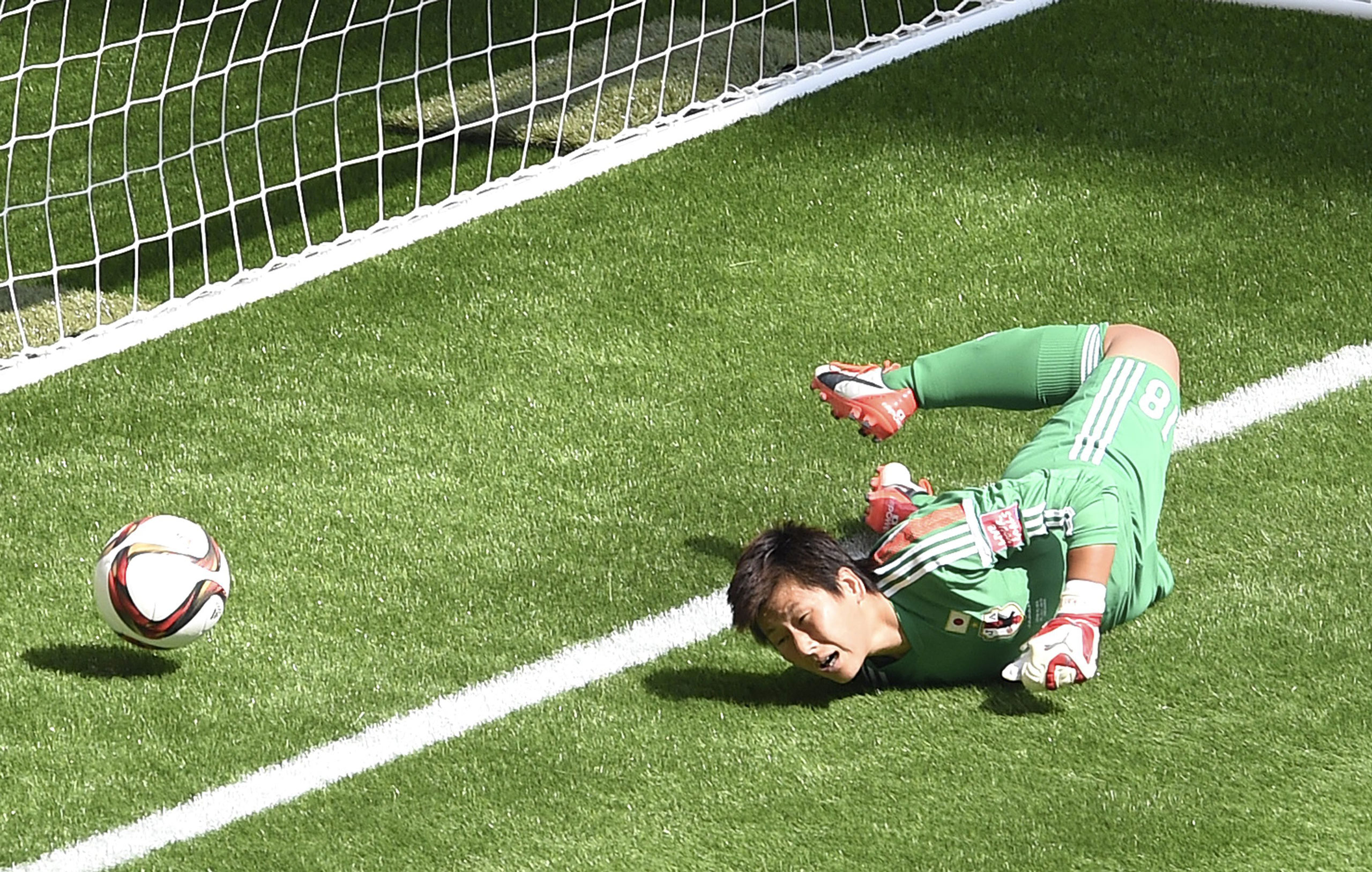 Japan's goalkeeper Kaihori Ayumi fails to hold the ball during the final match of the 2015 FIFA Women's World Cup at the BC Place Stadium in Vancouver on July 5, 2015.
