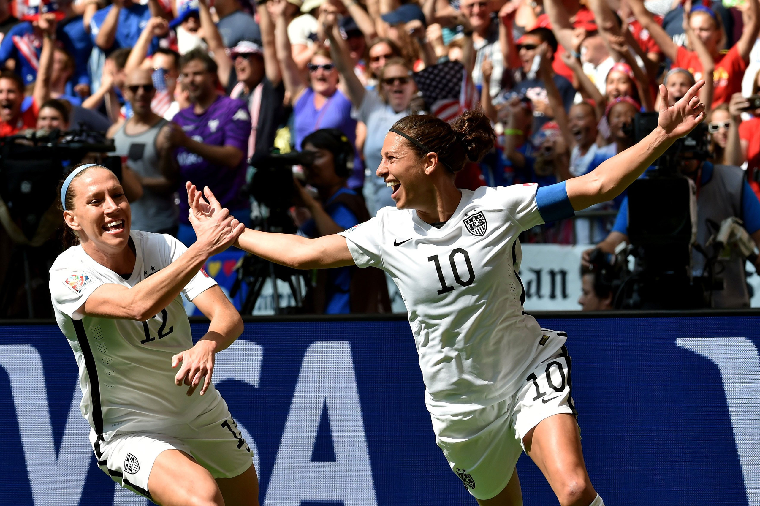 Lauren Holiday and Carli Lloyd celebrate with teammates after Lloyd scores her second goal against Japan in the final match of the 2015 FIFA Women's World Cup at the BC Place Stadium in Vancouver on July 5, 2015.