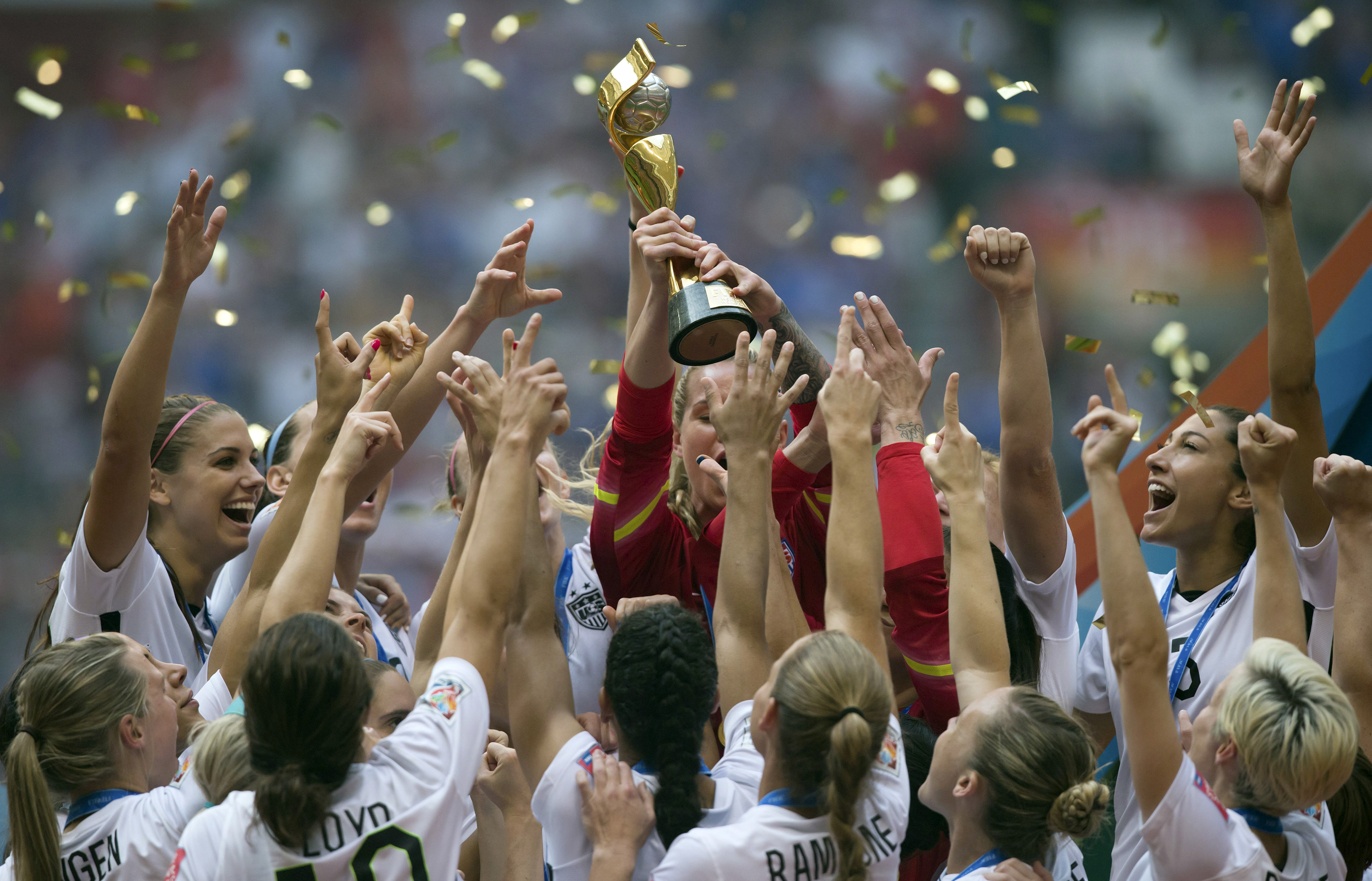 The U.S. Women's National Team celebrates with the trophy after they defeated Japan 5-2 in the FIFA Women's World Cup in Vancouver on July 5, 2015