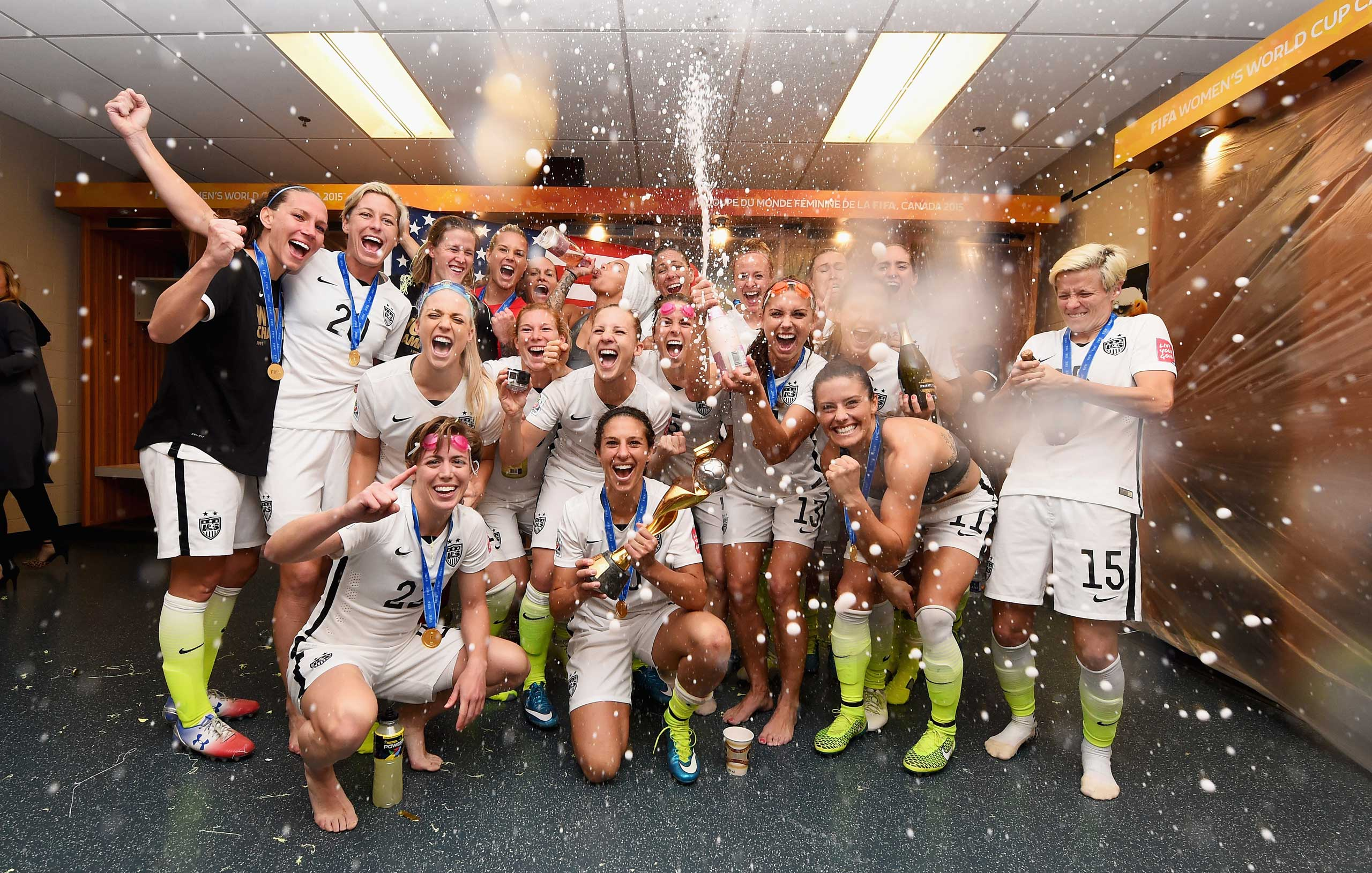 Carli Lloyd of USA celebrates with the trophy and her team mates in the locker room after winning the FIFA Women's World Cup 2015 Final between USA and Japan at BC Place Stadium on July 5, 2015 in Vancouver, Canada.