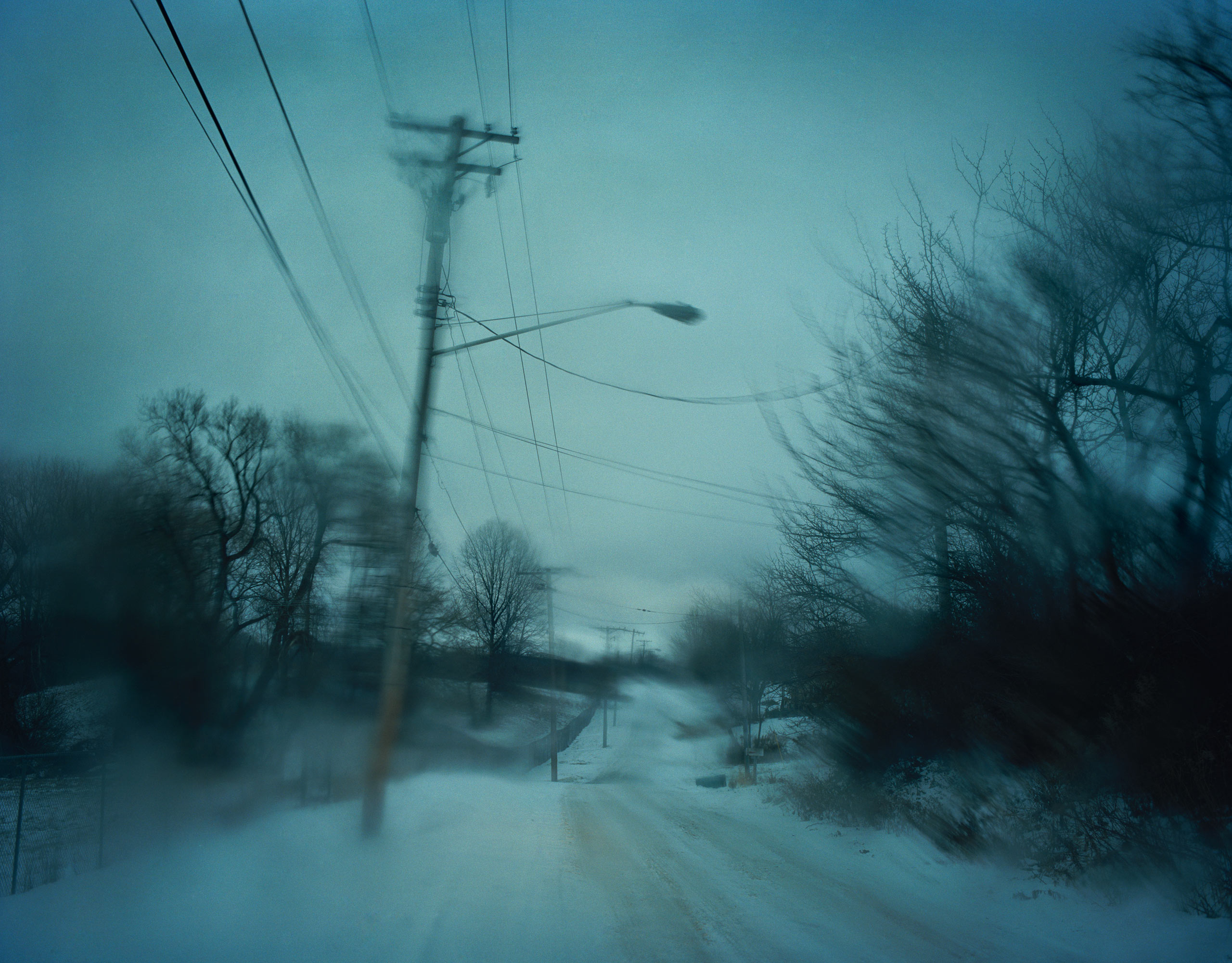 Todd Hido has recently added digital cameras to his equipment. Still he uses three to four cameras, both analog and digital, when shooting, for the different aesthetics they present.                               For this landscape photograph, Hido used an analog camera, a Pentax 67.