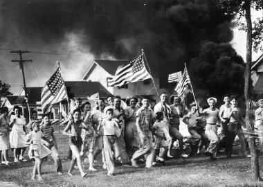 V-J Day New Orleanians, after celebrating the end of the war prematurely three times, let loose with everything they had when the official world of peace spread through the streets Tuesday near dinner time.