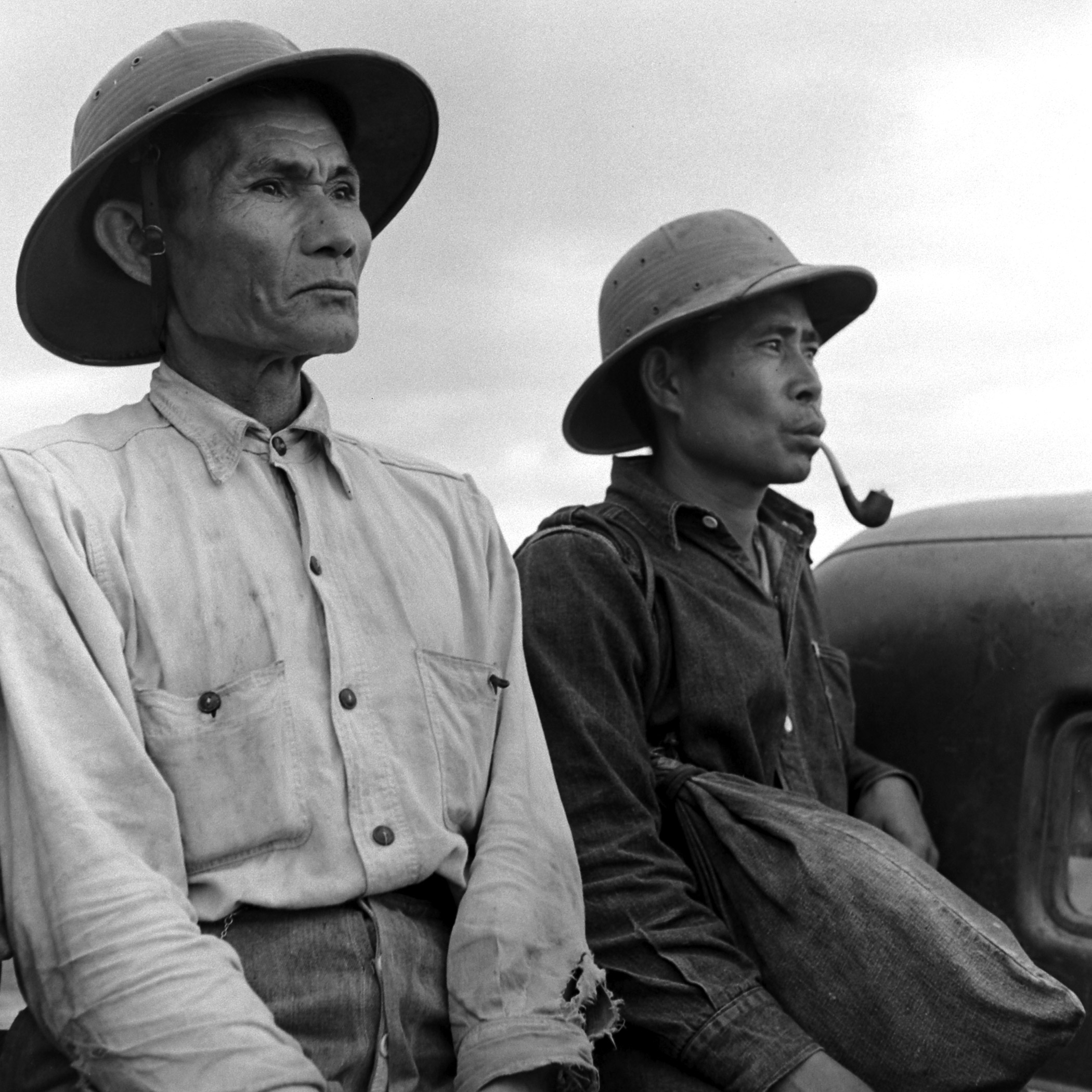 A portrait of two farmers in Hawaii.