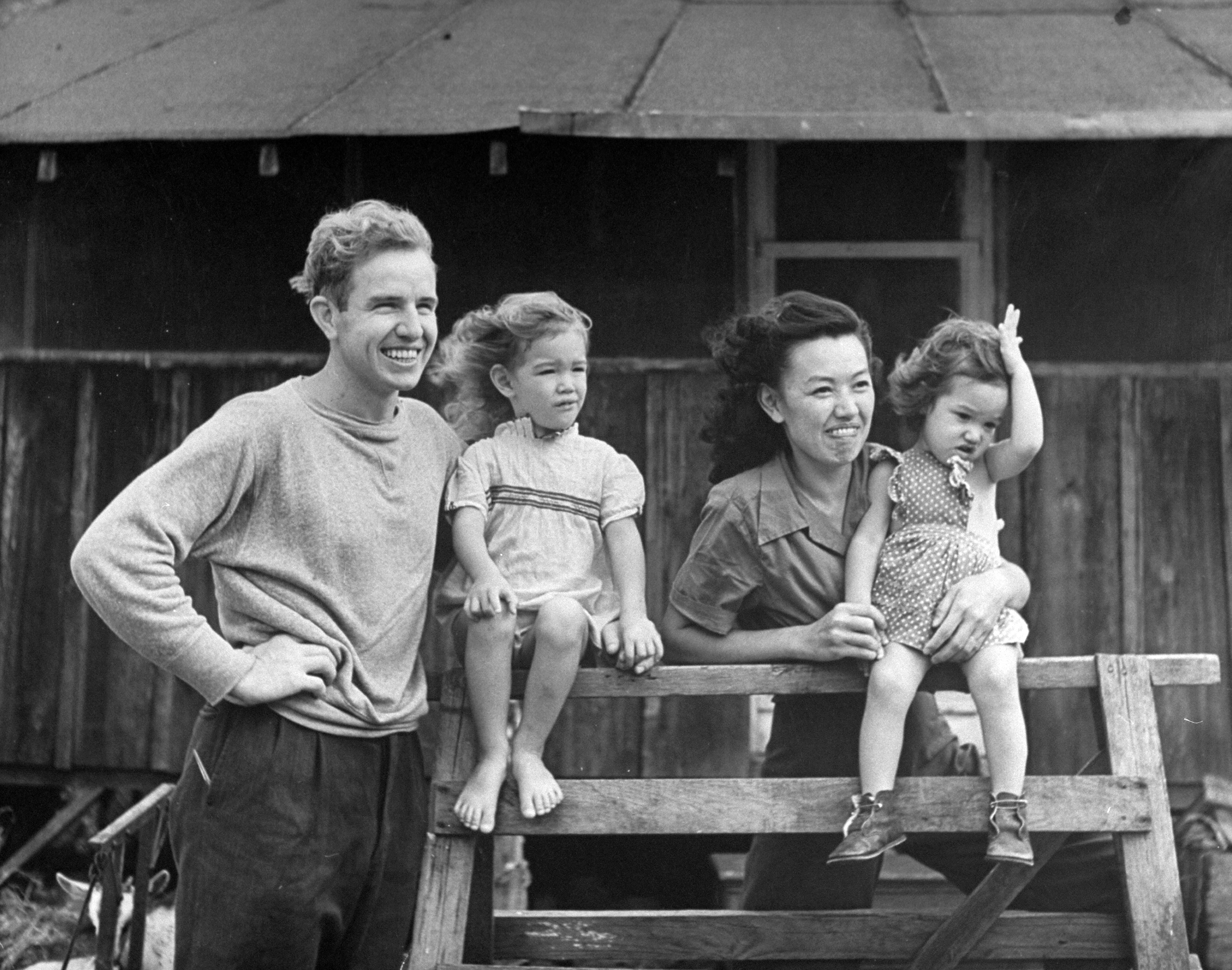 <b>Caption from LIFE.</b> Indiana Quaker, Sam Lindley, married a Chinese Quaker and has two fair haired girls, Renie and Renda. He raises goats and works as librarian at the University of Hawaii. He studies Chinese, wants to visit China.