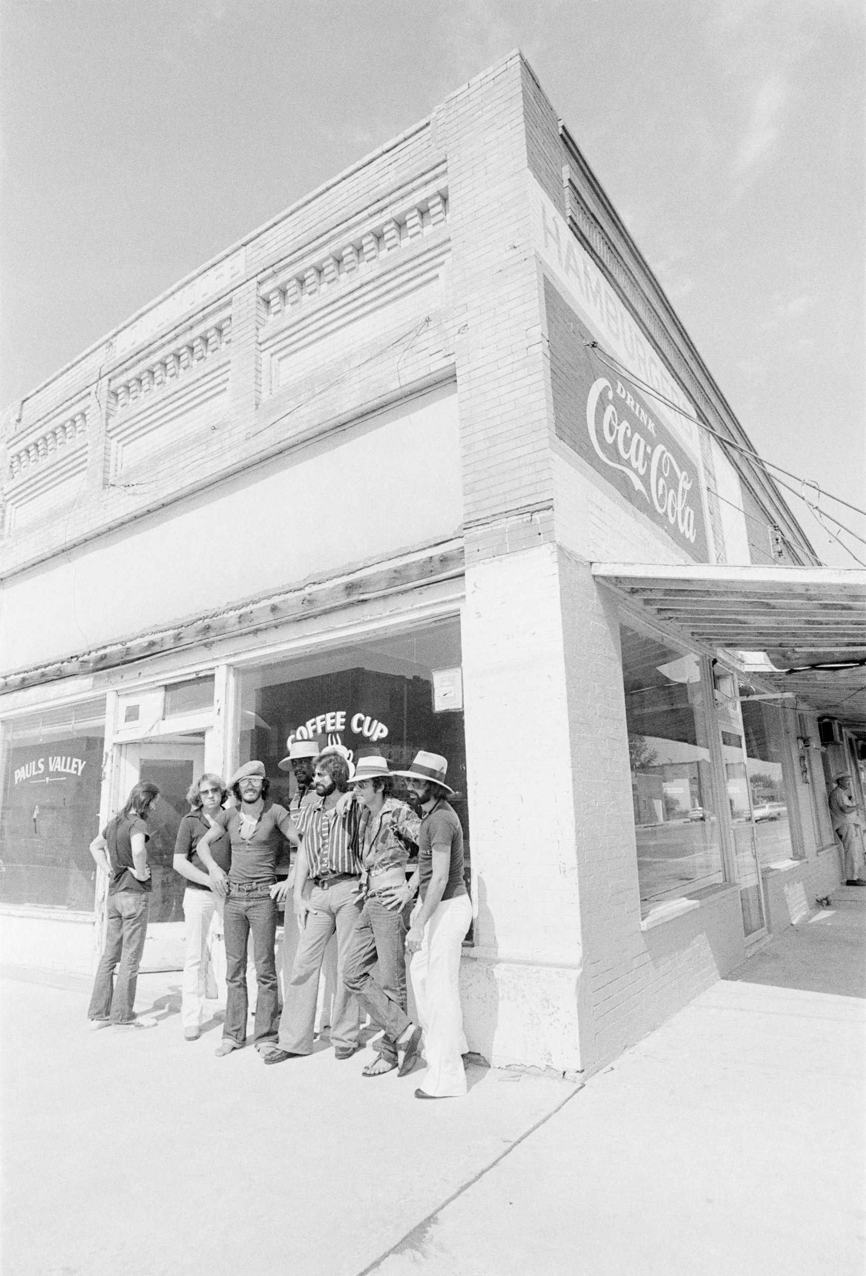 Bruce Springsteen and the E Street Band in front of the Coffee Cup Cafe in photographer Barbara Pyle's hometown of Pauls Valley, Oklahoma.