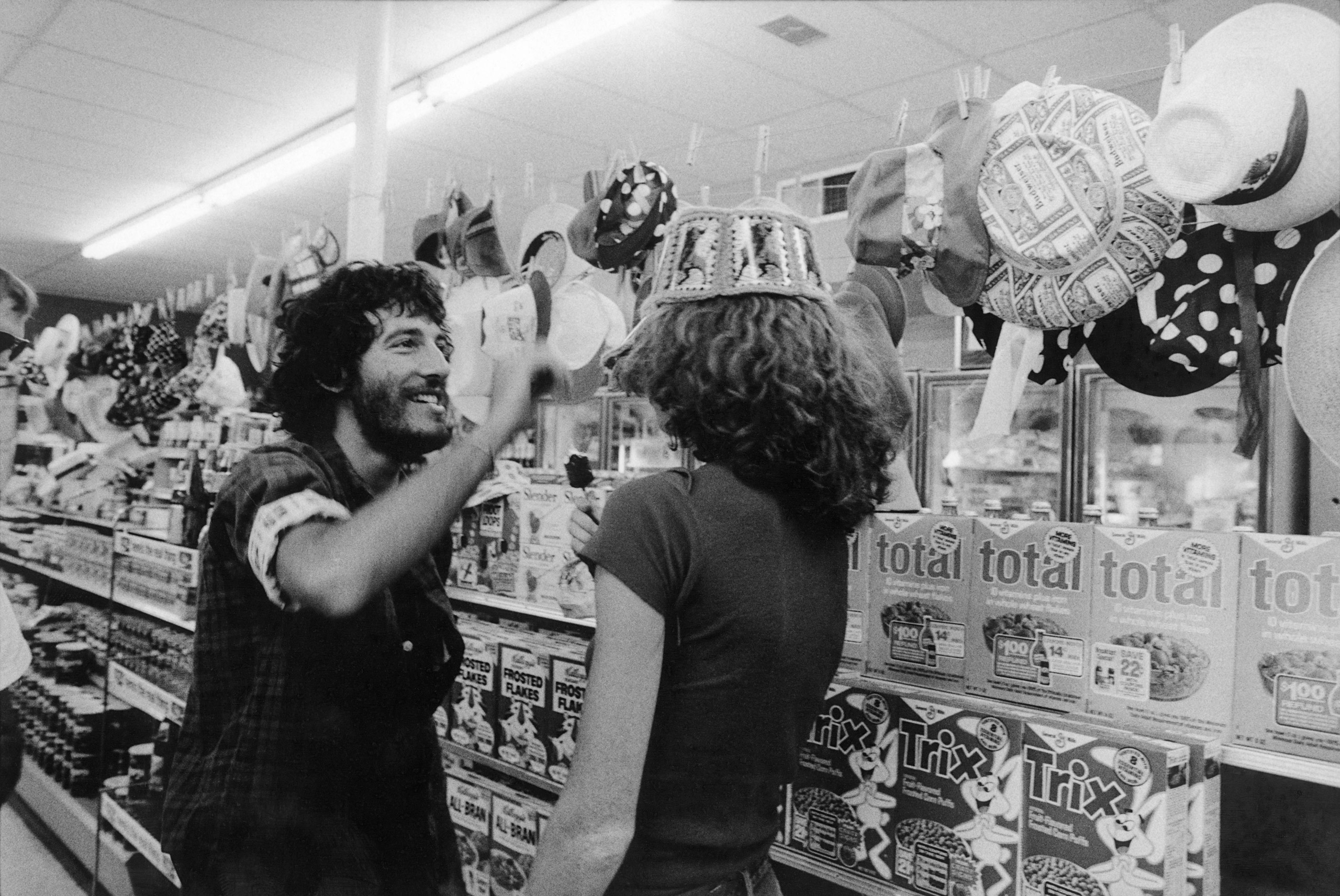 Springsteen with his girlfriend at the time, at one of the many convenience stores the band stopped at while on the road.