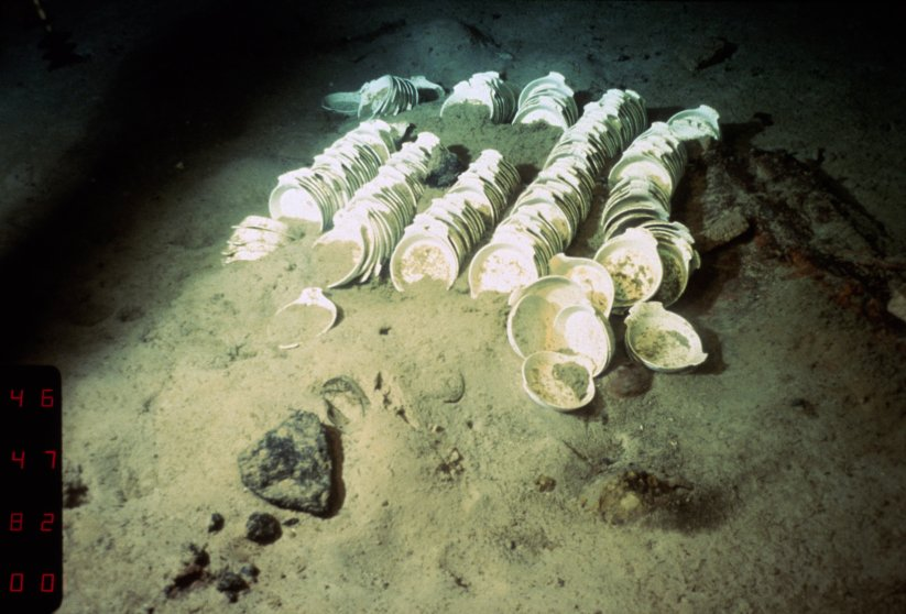 ca. 1985 --- China dishes are part of the debris left from the wreck of the Titanic, as she lies on the Atlantic Ocean floor south of Newfoundland.