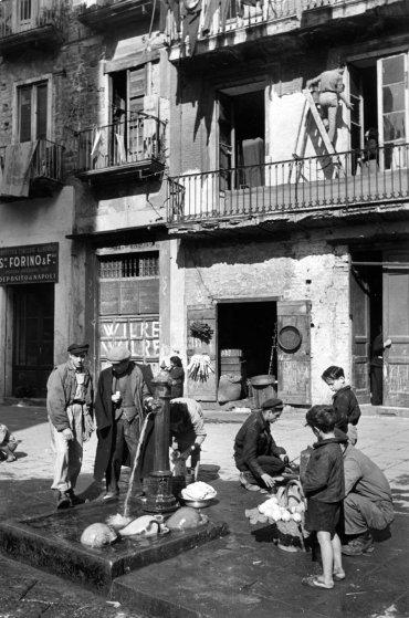 Water fountain in slum neighborhood. Naples, Italy, 1947.