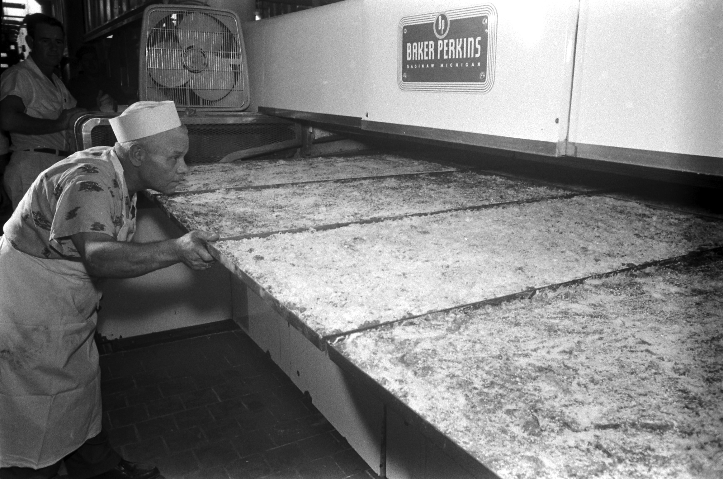 A 10-foot pizza going into the oven.