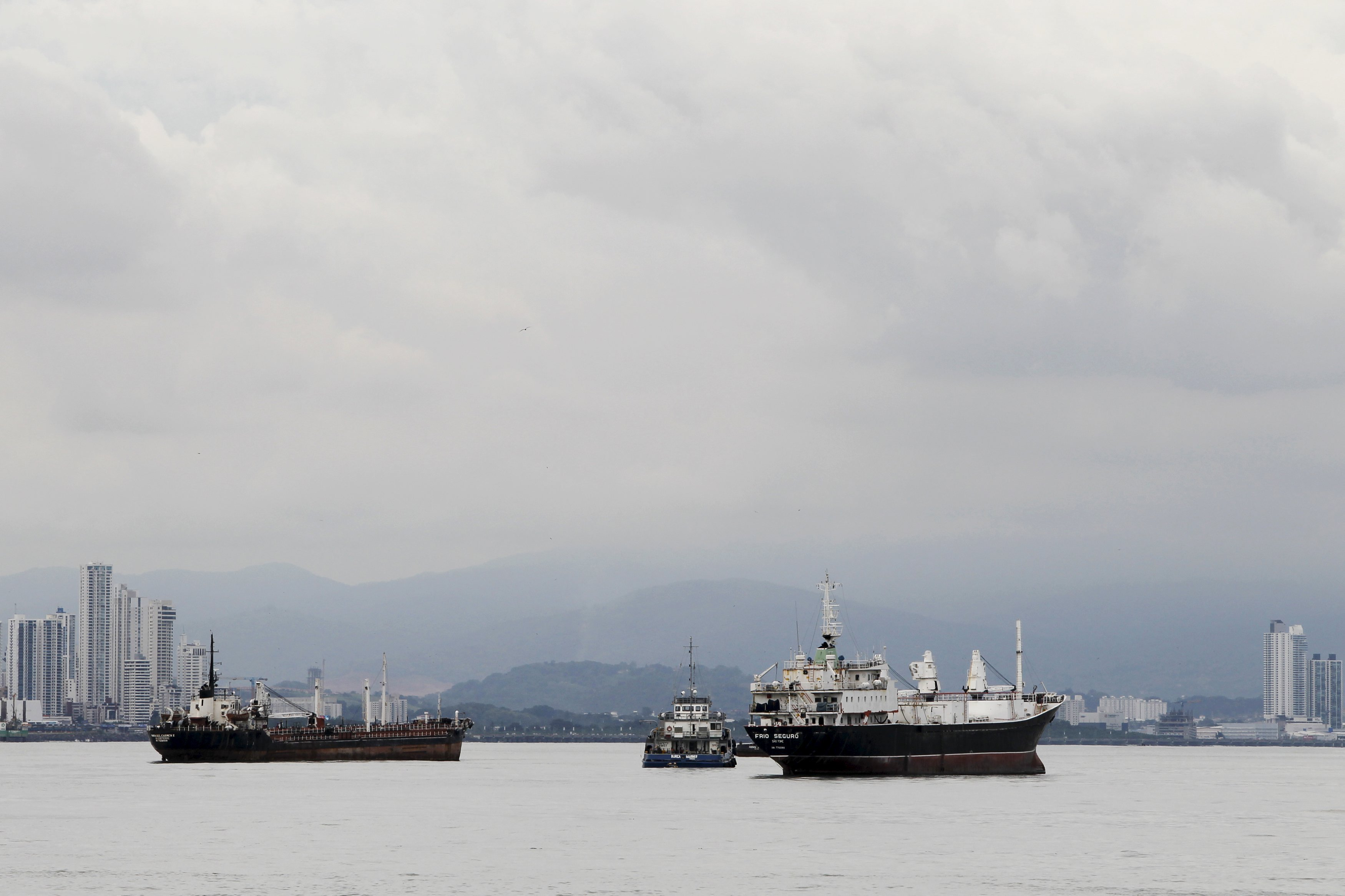 Cargo ships are seen as they wait to navigate through the Panama Canal on the pacific side of Panama City on Aug. 10, 2015.