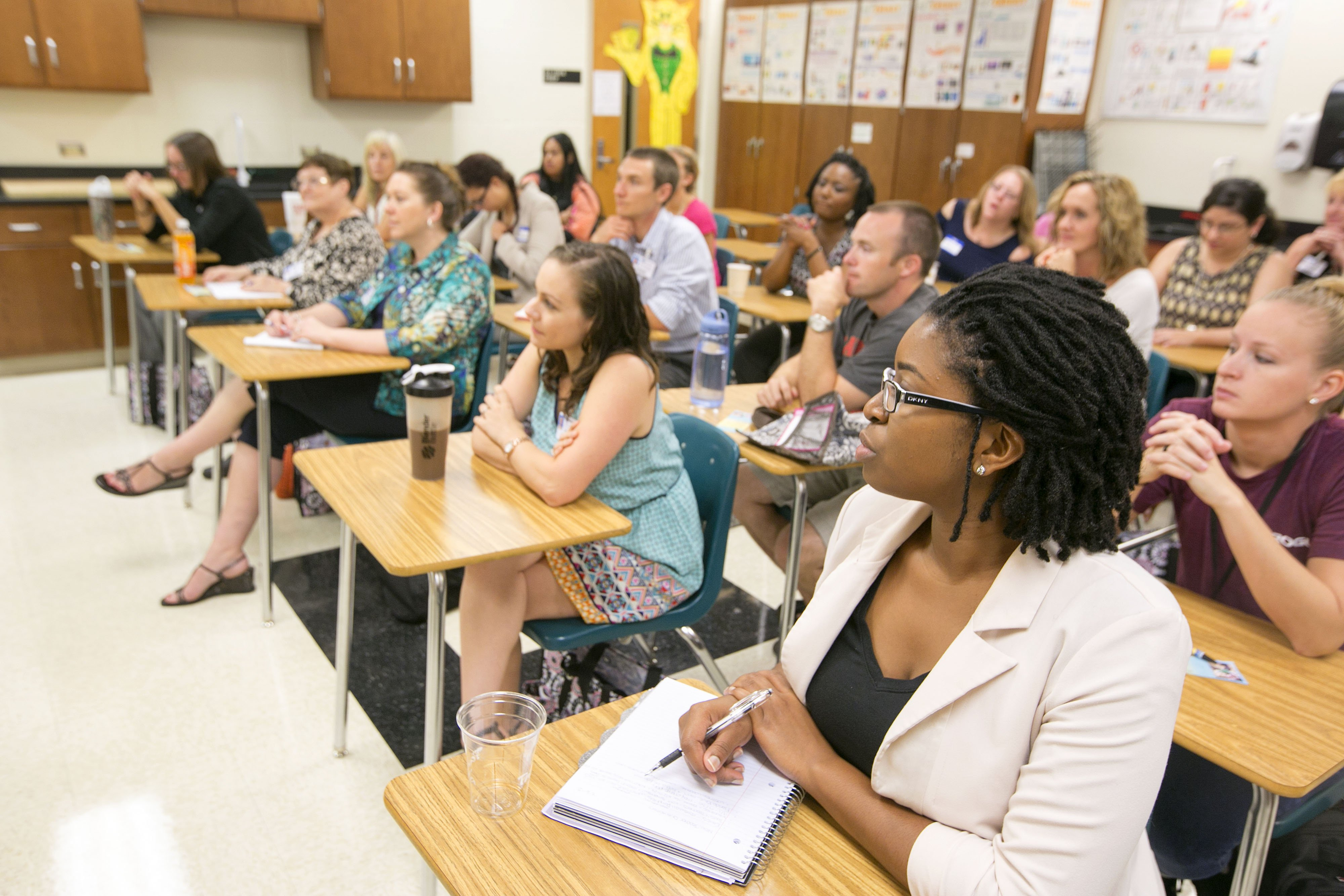 New teachers listen to veteran teaches during a break out session at Marion County Schools New Teach Orientation in Ocala, Fla. on Aug. 6, 2015.