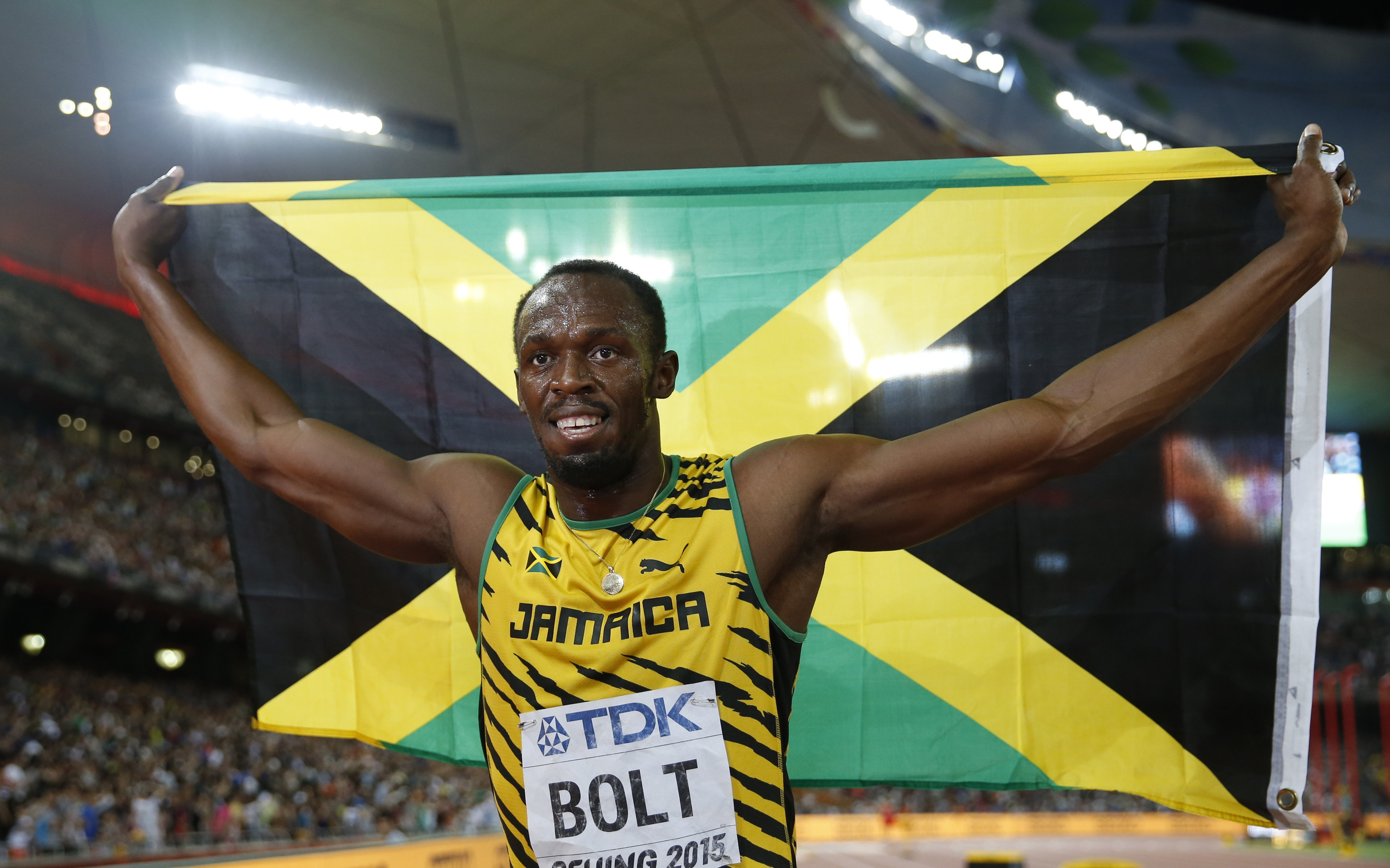 Jamaica's Usain Bolt celebrates after winning the gold medal in the men's 100m ahead of United States' at the World Athletics Championships at the Bird's Nest stadium in Beijing on Aug. 23, 2015.