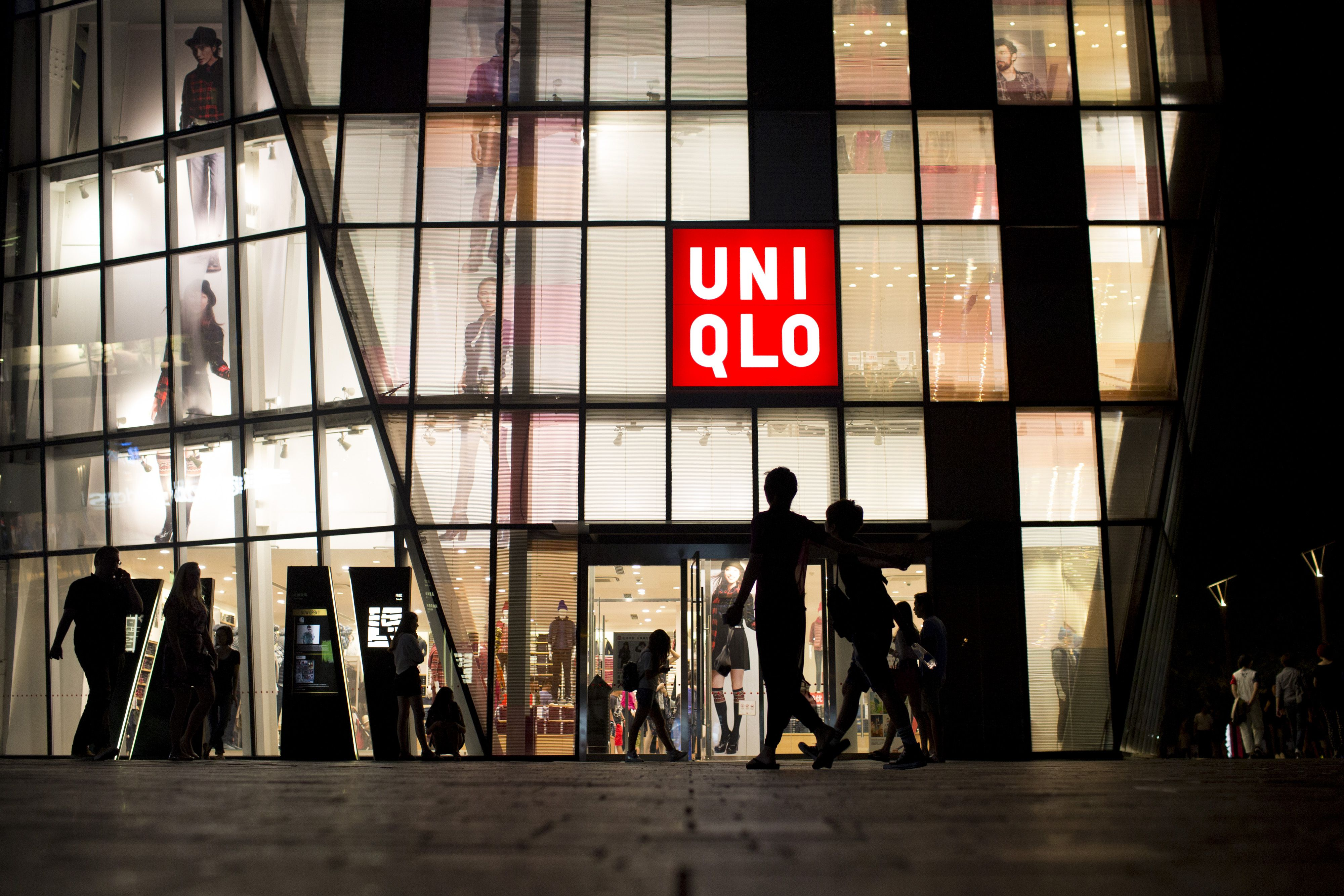 Pedestrians walk past a Uniqlo store in Beijing, China.