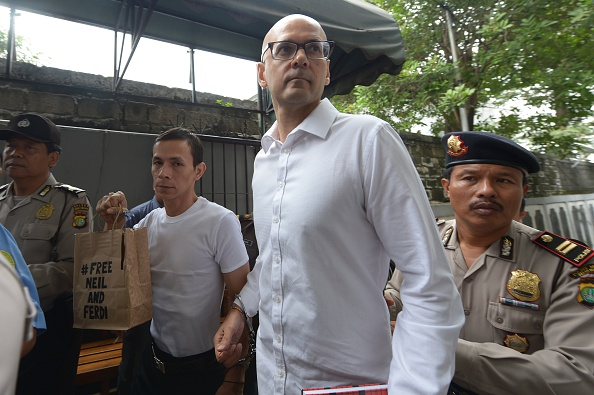 Canadian teacher Neil Bantleman (2nd R) and Indonesian teaching assistant Ferdinand Tjiong (2nd L) arrive at the South Jakarta court in Jakarta on December 2, 2014