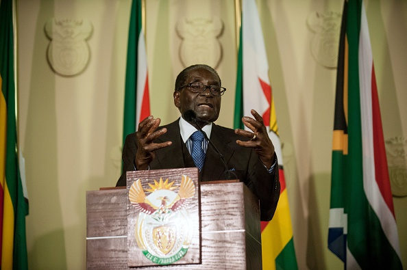 Zimbabwe's President Robert Mugabe delivers a speech along with South Africa's President before the signing of various memorandum of understanding between the two countries at the Union Buildings in Pretoria on April 8, 2015