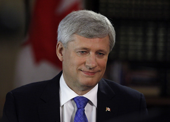 Stephen Harper, Canada's prime minister, smiles after a Bloomberg Television interview in Ottawa, Ontario, Canada, on July 29, 2015