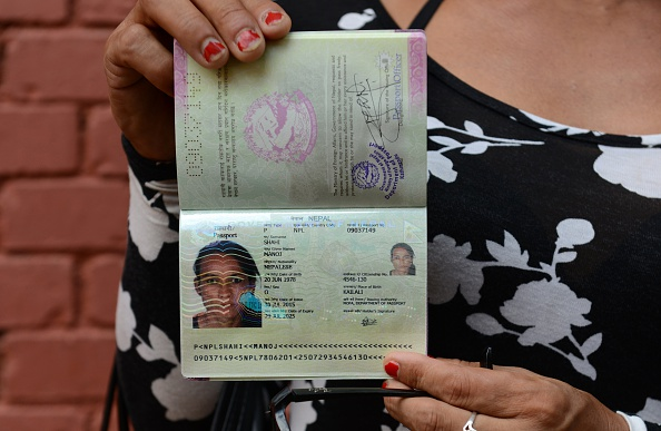 Nepalese transgender and the first recipient of a Nepalese transgender passport, Monica Shahi from Kailali district displays her new passport with  O  for other in the document's gender section, in Kathmandu on August 10, 2015